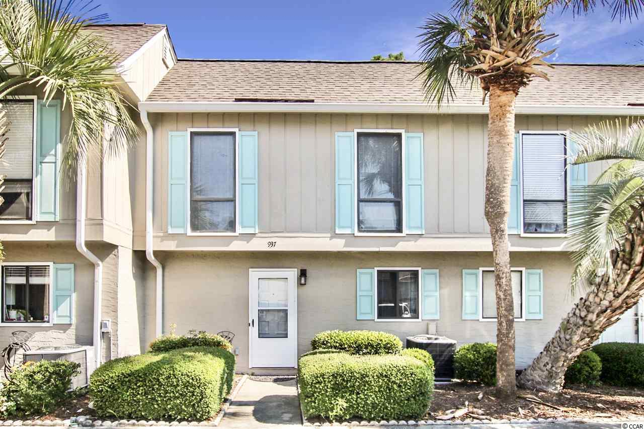 This beautiful 3 bedroom, 2.5 bath townhouse style home is located in the heart of the highly sought after Tilghman Beach section of Ocean Drive.  Completely remodeled unit includes all new flooring throughout, new roof and HVAC. Meticulously maintained and only used as a second home.  Spacious lower level includes a large living room, separate dining area, and Carolina room. Carolina room not included in listed square footage. Upstairs the master suite includes a private balcony overlooking a wooded area, as well as two guest bedrooms and a full guest bath. Just a quick golf cart ride to the sandy shore with ample public beach access. Robbers Roost community amenities include an outdoor pool, tennis courts, shuffleboard court, and community center. Conveniently located near shopping, dining, and entertainment. Check out our state of the art 3-D Virtual Tour.