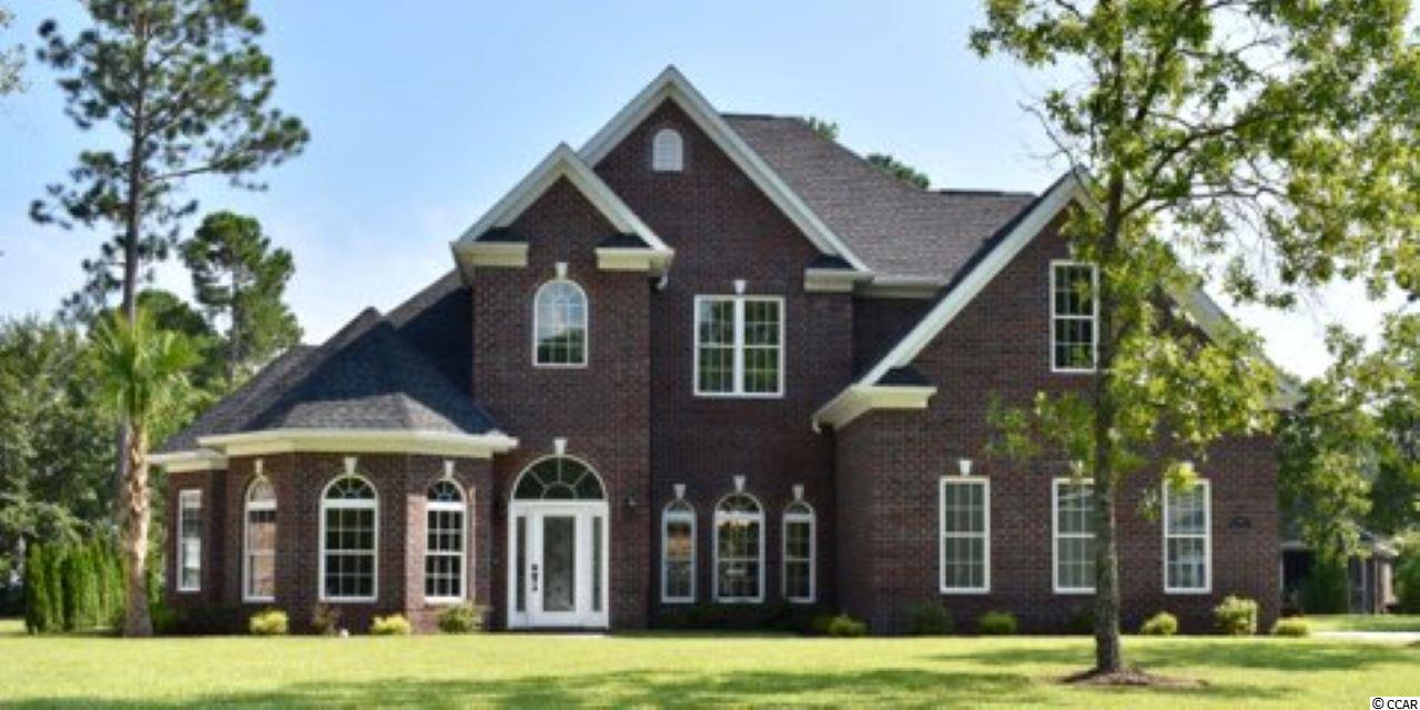 This palatial all brick 3500 sqft home on a corner lot is one of the larger homes in the Legends golf course community and sits on almost half an acre.  It has an open plan layout with plenty of light and  floor to ceiling windows in some areas.   There are 5 bedrooms and 3.5 baths with top quality wood flooring on entire first floor.  High end finishes on stairs and numerous architectural trim detail throughout house. First floor has 10ft ceilings, two story foyer and family room with coffered ceilings in formal dining and family room and triple tray ceiling in Master bed.  MB has two custom walk in closets, jetted tub, double vanities, shower with waterfall tile inlay and shower jets.  Kitchen has copper etched sink, Samsung appliances and a center island (which can be removed if desired).  Laundry room and two pantries near kitchen with a two car fully insulated attached garage.   Two large storage areas – one on second floor and the other in attic to store extra stuff.  Additional features include a large patio, sprinkler irrigation system and landscape lighting. The neighborhood is secluded from the bustle and bustle of the tourist areas but only a short drive to Tanger outlets, restaurants and the beach.   This home is nothing short of luxury living with a southern twist.