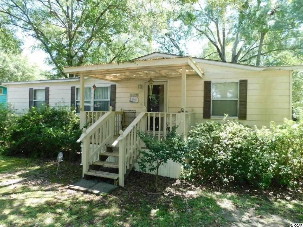 This charming and quite spacious 3 bedroom/2 bath manufactured home sits on a large corner lot and features an extra large screened in porch with EZ Breeze window treatments giving you use of the room in all seasons! Waterford Oaks is located only a half mile from the Garden City Pier and within golf car distance to multiple restaurants, grocery and convenience stores! There's even a private boat  ramp in the community to launch your boat or kayak into Murrells Inlet. Whether you're looking for a primary home or vacation retreat, book your showing today, THIS HOME IS PRICED TO SELL. There is an additional storage building/workshop to house your golf cart and beach toys. THIS IS A MUST SEE! Square footage is approximate and not guaranteed. Buyer is responsible for verification.