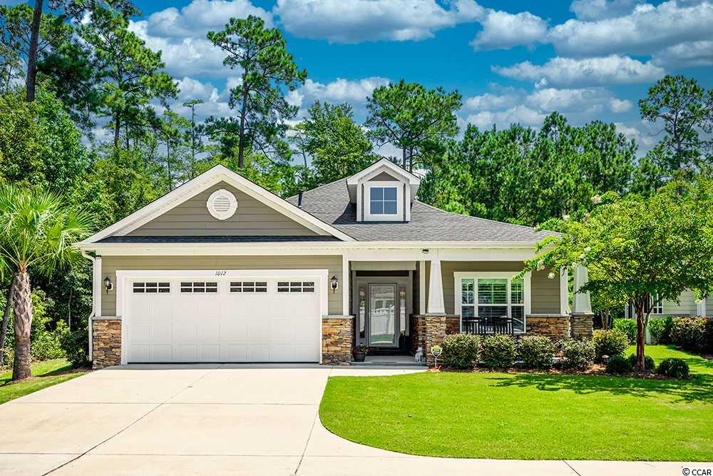 LOCATION and MAINTENANCE FREE LIVING is the perfect combination!!!  What a beautiful and well-maintained home ~ built in 2015 & located in Stonegate of Prince Creek in Murrells Inlet.  Enjoy privacy?  This particular PREMIUM lot is calling YOU!!!  Protected green space on the left and back of the home will always remain & no neighbors out front!  The kitchen has been beautifully upgraded to include quartz countertops, complimenting backsplash, and tile flooring.  All Stainless Steel appliances will convey.  For the natural gas enthusiast, there is a gas stub already in place ~ the current stove is electric.  Enjoy open living at its best with a floor plan that flows.  The back porch was recently converted to a Carolina Room.  The siding was replaced with shiplap, exterior insulation was installed as well as heating & air, making the Carolina Room a welcoming space all four seasons of the year.  Natural Gas appliances include Water Heater, Fireplace & Heating. Other upgrades include: Plantation Shutters/and blinds in each room, sealed garage floor, Helo whole house air filter purification system, Helo Guardian water filter, Hot water recirculation system, extended parking pad, AND Gutter Guards (maintained by HOA).  Garage shelving and storage units will convey as well as a custom bookcase in guest bedroom can convey or be removed.  Washer & Dryer will remain.  The community offers a pool, clubhouse, fitness center, and an active community for those that wish to join in (on hold for now due to Covid-19).  Dining, shopping, medical, entertainment are all close at hand.  The Marshwalk, Huntington Beach State Park, Brookgreen Garden, GOLF, and the BEACH are just a short drive away.  Easy to see ~ set an appointment right away.