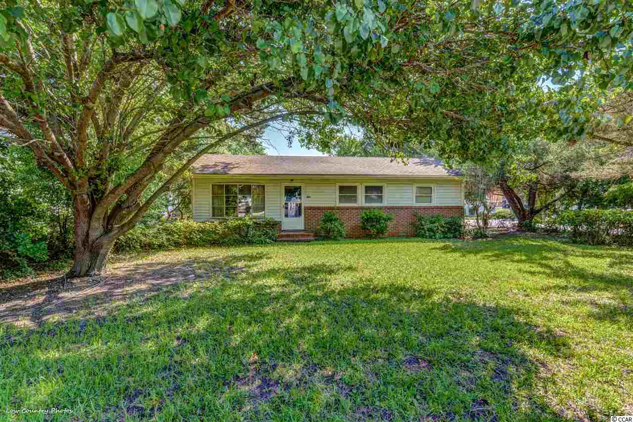 """3 Bedroom, 2 bath home on a .21 acre corner lot just two blocks to the beautiful Atlantic Ocean. Original Oak Hardwood Floors 3/4""""x2"""" planks.  Tongue & groove Pine walls.  Torozo tile flooring.  This home features a Sunroom, den, eat-in area a carport and detached 2 car garage.  A wonderful opportunity to own so close to the beach! This home is near everything in Surfside Beach, restaurants, shopping, park, dog park, library, tennis court and of course the beach and pier."""