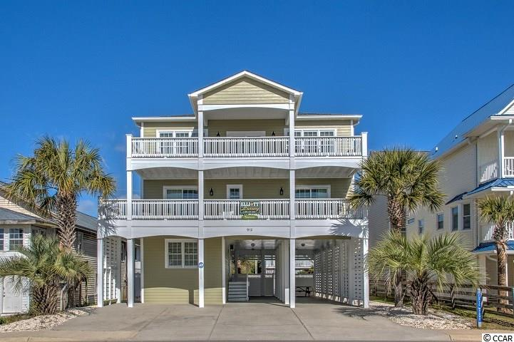"""Pick your rocker and sit back, feel the breeze, and enjoy the expansive unobstructed ocean view from this 5 bedroom, 51/2 bath, awesome home on the second row in North Myrtle Beach. Beach access is directly across the street.   If you don't want to get sand between your toes, just step to the back yard and take a dip in your own private swimming pool or enjoy a game of pool in the game room on the first level of this 3 level home.  The floors are all real 3/4"""" oak wood flooring and ceramic tile.  Kitchen is equipped with granite countertops and ss appliances.  The master suite is on the top floor to enjoy the unending breath taking views. Sit on the large covered decks on 2 levels of the home and breath in the salt air as you sit in the comfy adirondack chairs. This home sleeps 18 with 2 queen beds in 4 bedrooms and a king bed in the master.  All bedrooms, game room and living area on upper level are equipped with flat screen tvs.  This property has had consistent rental history since 2004. Call today to view this home with awesome view and across the street from the Atlantic. The home is between Ocean Blvd and Perrin with entry and parking from either street."""