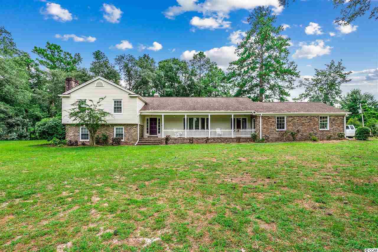"""Looking For That Perfect Home Where You Can Either Be """"In The Country"""" Or """"At The Beach"""" In A Matter Of Minutes? This Is It! Sit Out On The Front Porch Overlooking The Pond Or On The Rear Brick Patio Enjoying Your Morning Coffee.  This 3800 sq. ft. Home Is Just The Right Size To Meet The Needs Of A Larger Family, And Still Have Plenty Of Space For Entertaining. It Also Sits On 2 Acres And Has The Possibility for Subdivision. The Home  Boasts 5 Bedrooms & 4 Full Baths Along With 2 Separate Fireplaces, A Large Kitchen, Laundry Room, A 13 X 16 Brick Patio And Attached 2 Car Garage. All Of This And A Hybrid Heating System (Natural Gas & Electric) With 2 Multiple Zones. A Separate 36 X 38 Storage Building That Is Perfect For The Car Enthusiast, Contractor, Workshop Or Just Additional Parking Space, Just To Name A Few Ideas. Lets Not Forget The 2 Stable Stalls In The Back Of The Storage Building Along With The Fenced In Area That Can Be Used For Horses, Dog Kennels/Shelters, Uses Are Limitless! The Storage Building Is Set Up On It's Own Well For Water.  Very Close to Downtown Conway, The Beach And All The Restaurants, Shops And Entertainment That The Area Has To Offer!"""
