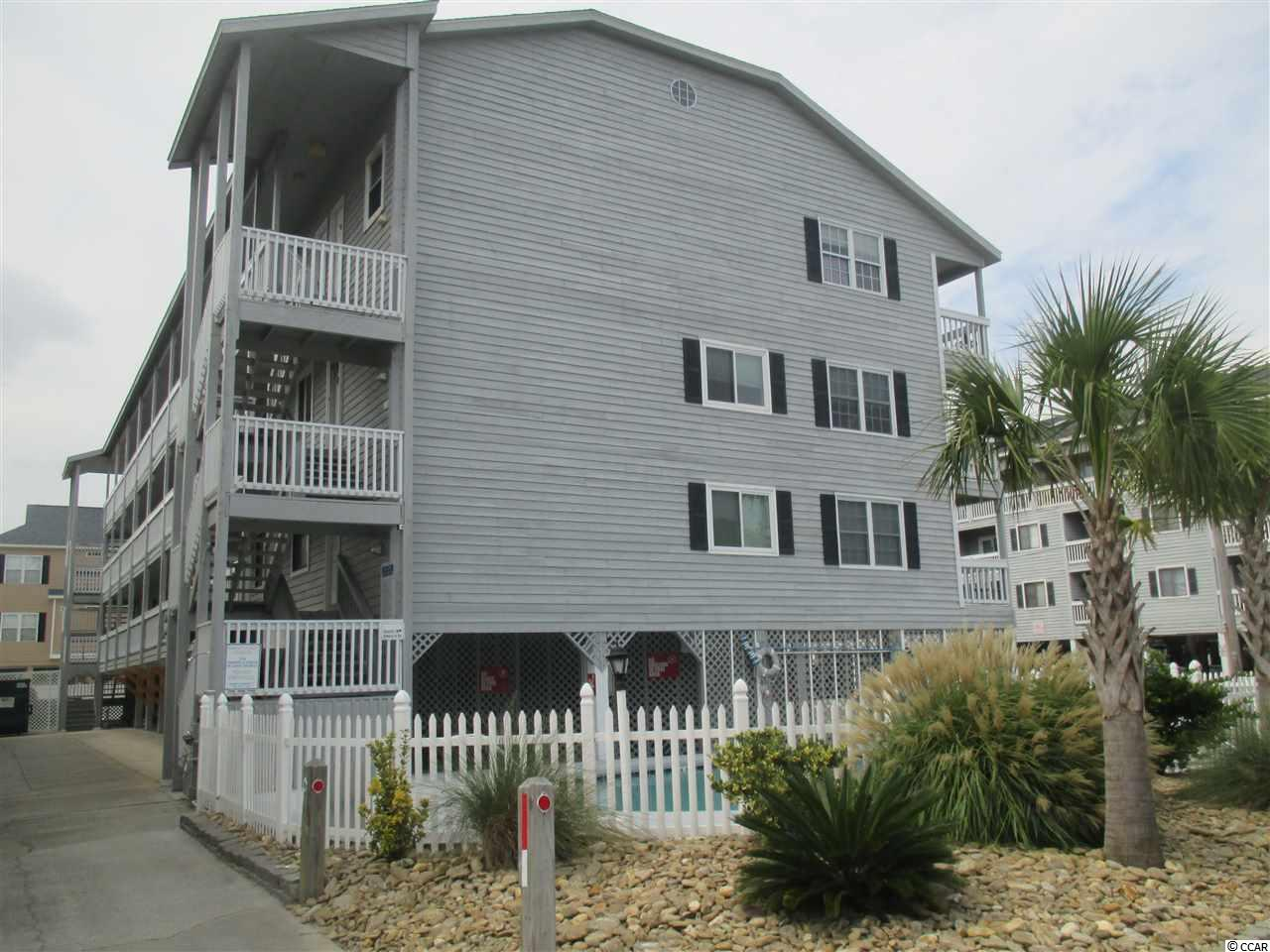 This 2 Bedroom 2 Bath re-modeled condo has fantastic views of the Atlantic Ocean from the deck, living area, and master bedroom. Condo 301 is a top floor end unit in the best location at the Sandy Shores I building and features : Stainless Steel Appliances, Cherry Cabinets, Double Sink, Stove Top Burners, Fisher Paykel Dishwasher, Granite Counter Tops  and Tiled Back Splash. The down stairs second bedroom's bath has an extra deep tub with a European Shower Head. The upstairs master bedroom has beautiful Wood Flooring, Port Hole Window with a view of the ocean, Glass Block Shower and Extra Storage. Amenities at Sandy Shores I are a Pool, Covered Parking and Outside Storage. The  HOA includes : Insurance, Cable TV, Water, and Trash Pick Up. This condo is the perfect second home, family vacation destination, winter retreat, investment with great rental income or full time retirement home. Call your Realtor immediately!! This is the chance of a lifetime to own a two bedroom two bath condo at THE BEACH.