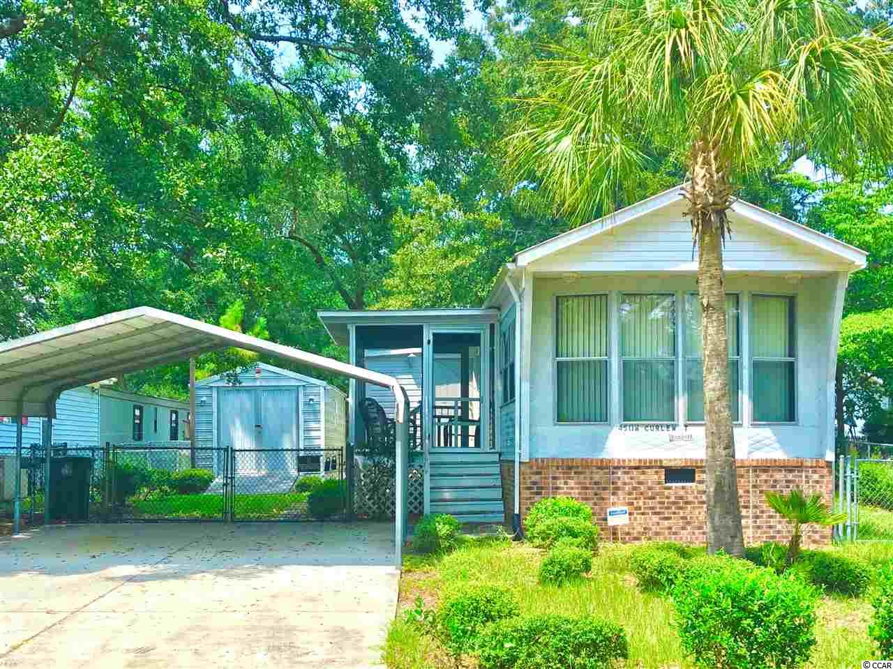 The coastal feeling is in the air!  Well-maintained, clean, spacious home on owned land in a fantastic location in the desirable Cherry Grove section of North Myrtle Beach is a rare find.  Convenient to everything the Grand Strand has to offer yet in a serene, lovely low country coastal setting. The marsh is just a few steps away where the views overlooking Cherry Grove inlets are astonshing!  Pelicans, egrets, gulls, and marsh views are plentiful in this picturesque area and the white, sparkling sand of the beach is just minutes away.  Screened porch, brick foundation, fenced yard, carport offering room to park your boat, concrete driveway, and also a large shed. No HOA!!! No lot rent!!! Not in a designated flood zone!  This is a great value for serious cash buyers for a primary residence, awesome beach home, investment, or rental property.  Come enjoy the salt life!!!