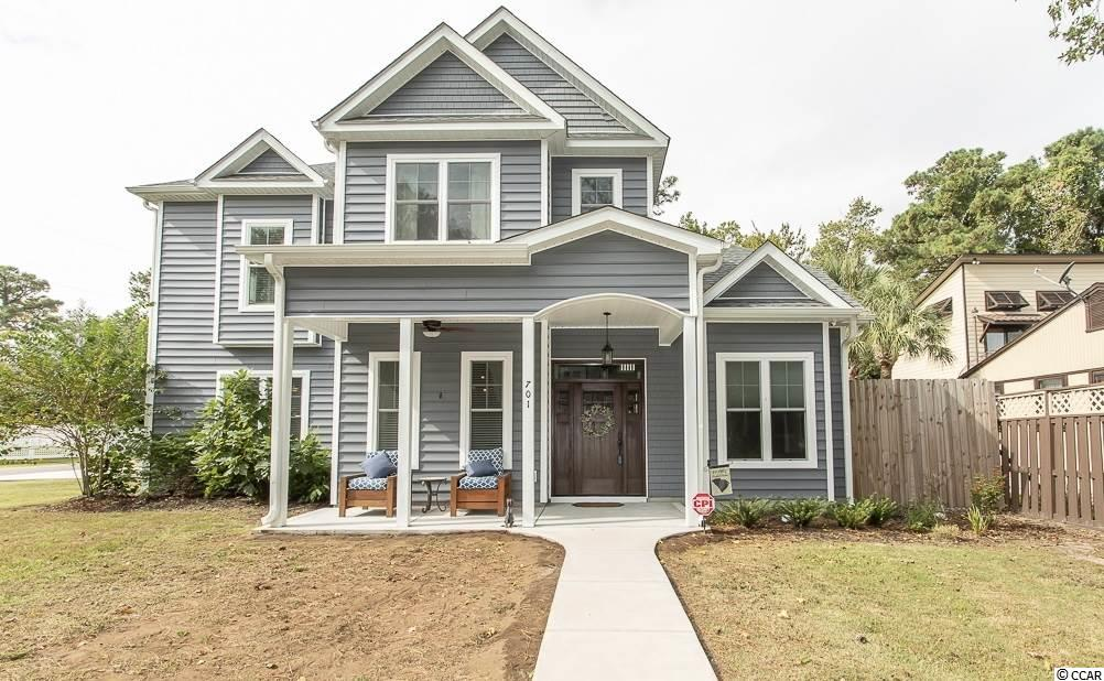 Located just blocks from the beach, this rare find is a dream come true! This like new, custom built 5BR/3.5BA home is located in the heart of Myrtle Beach with NO HOA! Great Value- Now priced below recent appraisal.This stylish home is loaded with a multitude of unique upgrades! Living Room boasts 15 ft ceilings, & 8ft high 4 panel glass doors allowing for the perfect amount of natural light. Open concept is perfect for entertaining guests. Spacious Study makes for a perfect office, man cave or theater room. Kitchen features include Leather Granite Counter Top, Granite Island with Breakfast Bar, Breakfast Nook with built in bench seating, Glass Induction Cook Top, Double Convection Wall Oven, and 42 inch custom self closing cabinets. Gorgeous LVP Flooring is throughout all main living areas. Elegant Staircase is made of real wood and makes a stunning centerpiece to the Living Room. 2 Masters Suites- one on each floor. Each floor has its own laundry room for added convenience. 1st Floor Laundry Room is the ideal drop zone to leave your beach towels. 2nd Floor Master Suite features a balcony perfect for relaxing or sun bathing. Luxurious Master Bathroom includes a custom glass tile shower, 12.5ft extended vanity, and a modern Soaking Tub with free standing floor mount faucet. Other features include Granite Counter Tops in all Bathrooms & Laundry Rooms, Butlers Pantry in Formal Dining Room, Floor to Ceiling Tile in all showers, outdoor shower with Hot & Cold Water, 3 climate zones, 8 ft doors throughout home, extended garage to fit full size truck, and so much more! Don't miss out- you must see this home to truly appreciate all it has to offer!   Measurements are deemed reliable and Exact Dimensions should be verified by Buyer or Buyer's agent.