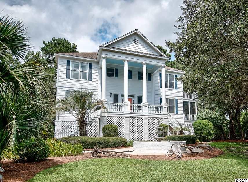 Welcome to the beach! This 4 bedroom 3 bath Beach Home in the quiet enclave of Royal Tern Court is perfectly located. There is immediate access to the beach, the Beach Club with all its amenities, and the Golf Club. To add to the allure, only moments away, the home has a shared deeded private dock on DeBordieu Creek. This provides immediate boat access to the DeBordieu creek system and pristine North Inlet. The master bedroom is located on the first floor with an adjoining screened porch, large bath with Jacuzzi, and ample closet space. A den, guest room with bath, and laundry are on that floor as well. The upper level has two additional bedrooms and bath, a large spacious living room with vaulted ceiling, a dining area, and a screened porch with a creek/marsh view. The elevator services all floors from the large garage. This comfortable home offers a great opportunity for a family who loves all the amenities DeBordieu has to offer in one of the most convenient locations within the Community.