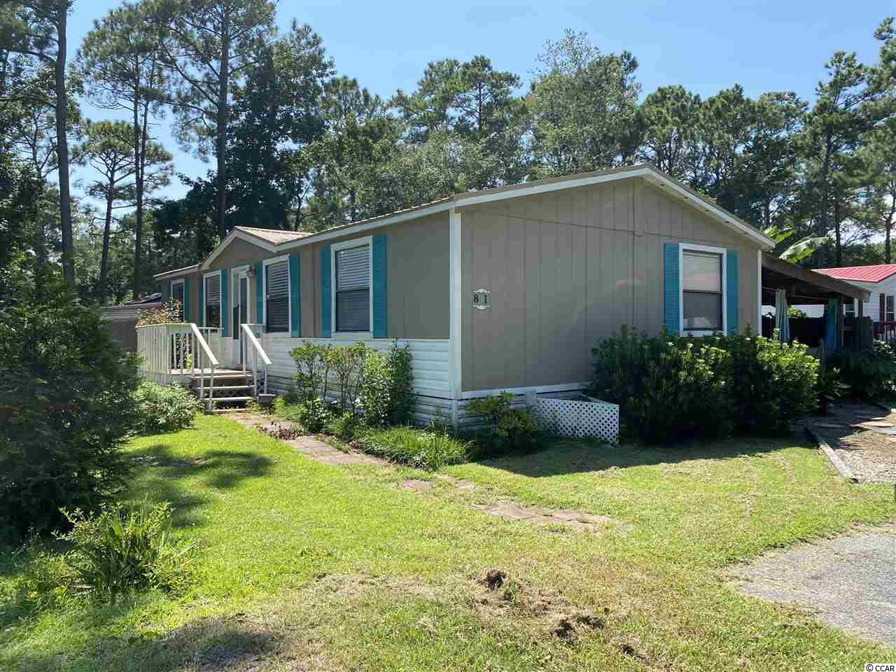 Wonderful spacious 3 bed, 2 bath home on leased lot in sought after Windjammer Village. Home is well decorated, sold furnished. Minutes from Garden City Pier & Marsh walk in Murrells Inlet. Home has a walk in closet, screened in porch, a relaxing sprawling covered patio with KOI pond providing more than enough space to grill or just chill and enjoy your favorite beverage.  Large back yard with covered shed for a golf cart or boat along with 3 additional sheds to store all your beach chairs and umbrella.  This is a great buy!!! Can be used as a beach get away or a permanent residence!!!  Come check it out!!!!