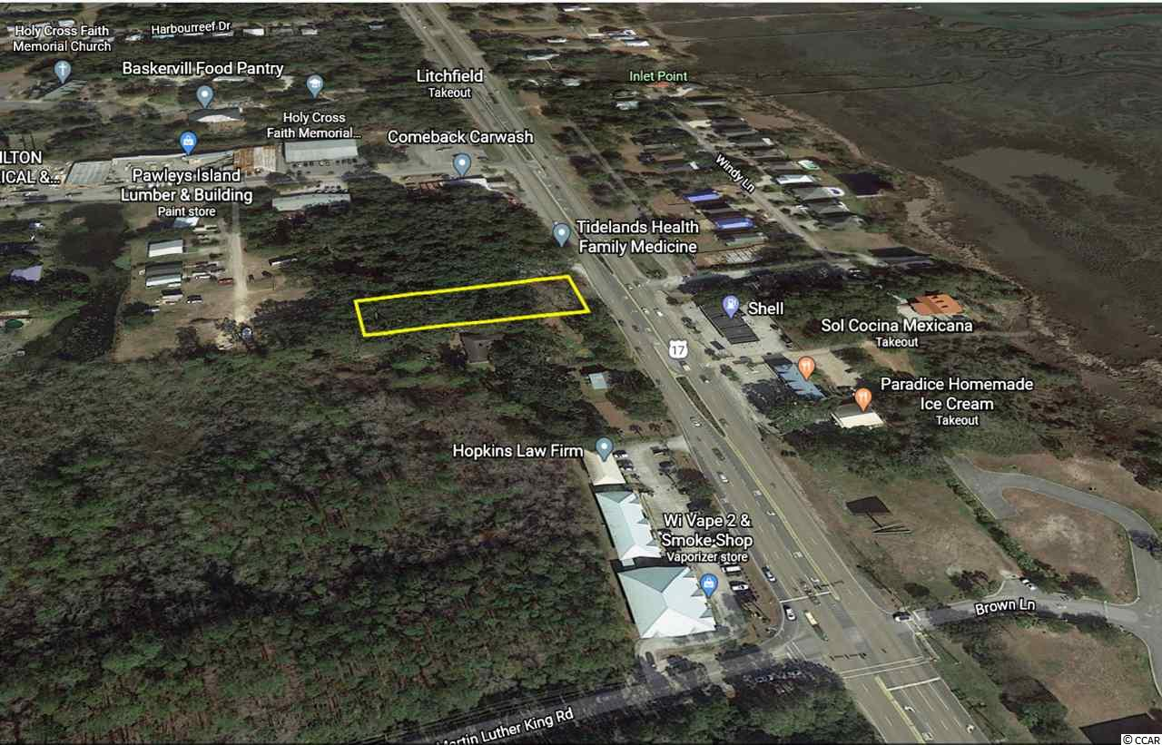 Vacant Lot located directly on Ocean Highway in Pawleys Island. Current zoning General Commercial (GC), which gives plenty of potential use options for this lot, even residential options.  Please contact listing agent for more details.