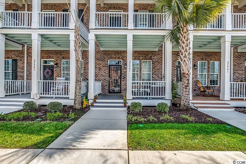 Unique Market Common townhome! This 2 bed, 2.5 bath townhouse is the only model of its kind currently available. The inside and outside of this property are equally as aesthetic. Entering the home you find the open living room and kitchen which feature hardwood flooring, granite counter tops, tile back splash, stainless steel appliances, & crown molding. The unit includes a balcony providing relaxing views of the Market Common, as well as a back patio/walkway that allows you to walk to the stores, restaurants, coffee spots, and bars of the community in seconds. The two spacious bedrooms are perfect for a small family or roommates. The master bathroom features a standing shower and separate bathtub, as well as granite counters. Walking out the back door, you find a small patio that leads to a walkway that will allow you to arrive at the stores, restaurants, & attractions of the Market Common in seconds. Private one car garage.