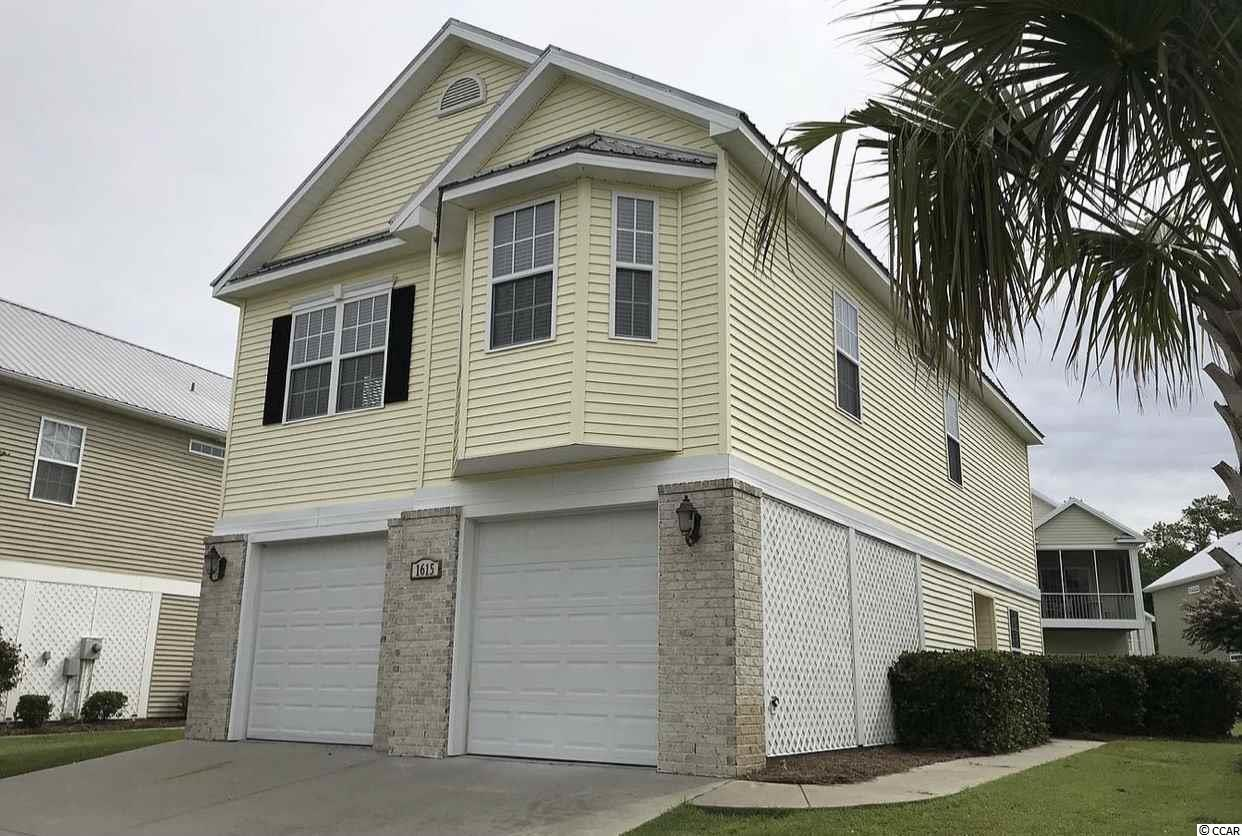 Cottages at The Surf is a private, quiet, gated community in North Myrtle Beach.  This beautiful 4 bedroom, 3 full bath home is boasts an open , split floor plan which features include  vaulted ceilings in living/dining and master suite, sliding door from dining area to screened porch,  stainless steel appliances, granite counter tops and tile floors in kitchen and baths.  Master suite features large bay windows, walk in closet and access to screened porch. Other two guest rooms and full bath are located on first floor, would make  a perfect mother in law suite. Cottages at the Surf offers an outdoor swimming pool and allows owners to have motorcycles and golf carts, it is just a short golf cart ride or walk to the beach, restaurants, Main St and everything else North Myrtle Beach has to offer!  Don't miss out , this is the only one for sale and won't last long!!!