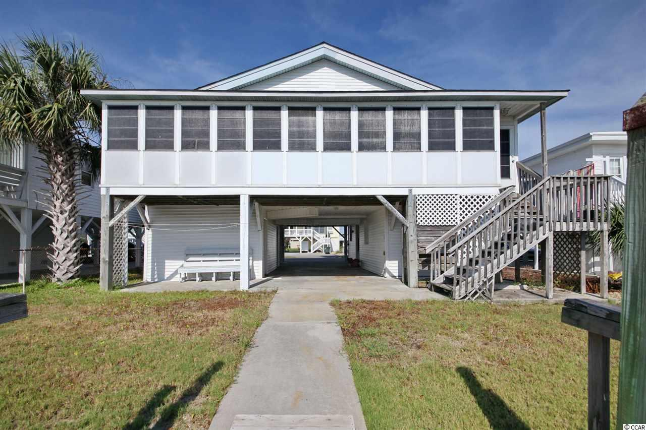 Raised Beach Home on the Channel in North Myrtle Beach offers 4 bedrooms and 3 baths. Charming family beach home has a screened porch on one side and a sun porch on the other, large kitchen with a breakfast nook and living room dining room combo. Light paneling on the walls and a beamed shiplap style ceiling throughout the entire home upsytairs.  All rooms have ceiling fans for those cooler nights when you can leave the windows open and hear the beach from only 2 blocks away! Additionally, there is a dock over the channel with built in seating. Parking for multiple cars under the home with a first floor storage room, and the 4th bedroom with kitchenette area and bath. Comfortable sleeping for up to 12 people so come bring the family and enjoy beach living.