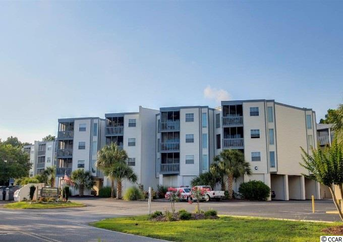 Ocean Green quite little community top floor end unit, 2 bedrooms, master bedroom has own bath, new sleeper couch, outdoor pool, new light fixtures, walk to outdoor pool, take a golf cart ride to the beach, stores, restaurants, golf course.