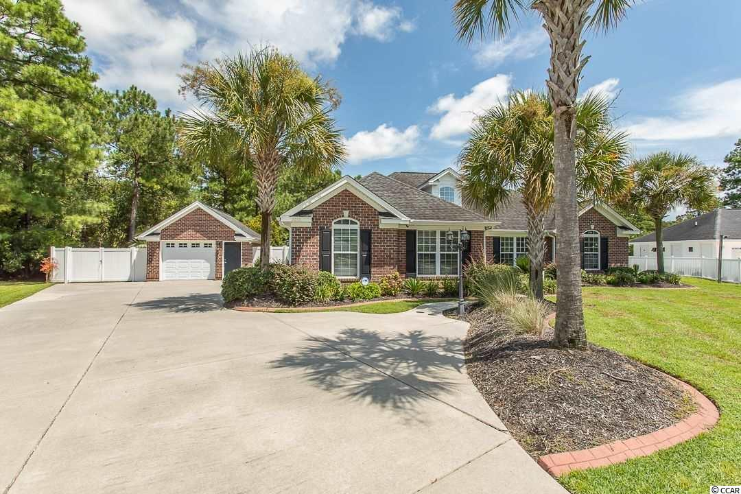 """Immaculate custom built 3 bedroom/2 bath 1868 sq ft all brick home with split bedroom and open floor plan plus large laundry room, three car garage with one detached (also brick) in the coveted Hunters Ridge Plantation of Myrtle Beach.  Only 10 minutes to MB airport and 15 to the beach.  Home features recent upgrades that include new flooring throughout (Brazilian cherry hardwood in living and master, new stain resistant carpet in two bedrooms), large walk-in closets in all bedrooms, porcelain tile in kitchen and baths, travertine in foyer, custom tile work in beautiful extra large spa/master bath with walk-in shower and jetted tub. Beautiful custom cabinets with island in kitchen and granite countertops throughout and built-in entertainment center.  Kitchen features all stainless appliances, 40"""" five burner gas top range with double oven, new French door refrigerator.  Home features gas fireplace, ceiling fans in all rooms, vaulted ceiling in the living room, tray ceiling in the kitchen and master, foyer with 18' high ceiling. Professionally landscaped yard with many palm trees and a breathtaking backyard starting with lawn irrigation, termite bond, privacy fencing, covered porch, custom paver patio with fire pit, spa tub under a gazebo and outdoor shower.  A four-acre lake at the edge of your back yard that has no other homes around it, you only see water and woods.  It completes your backyard oasis, but to top it off the community pool is next door - just steps away.  Plenty of parking for up to 8 cars in oversized driveway and also parking for small RV or boat.  This custom-built home also has a security system already installed!  Two award-winning schools close by complete this very quiet neighborhood."""