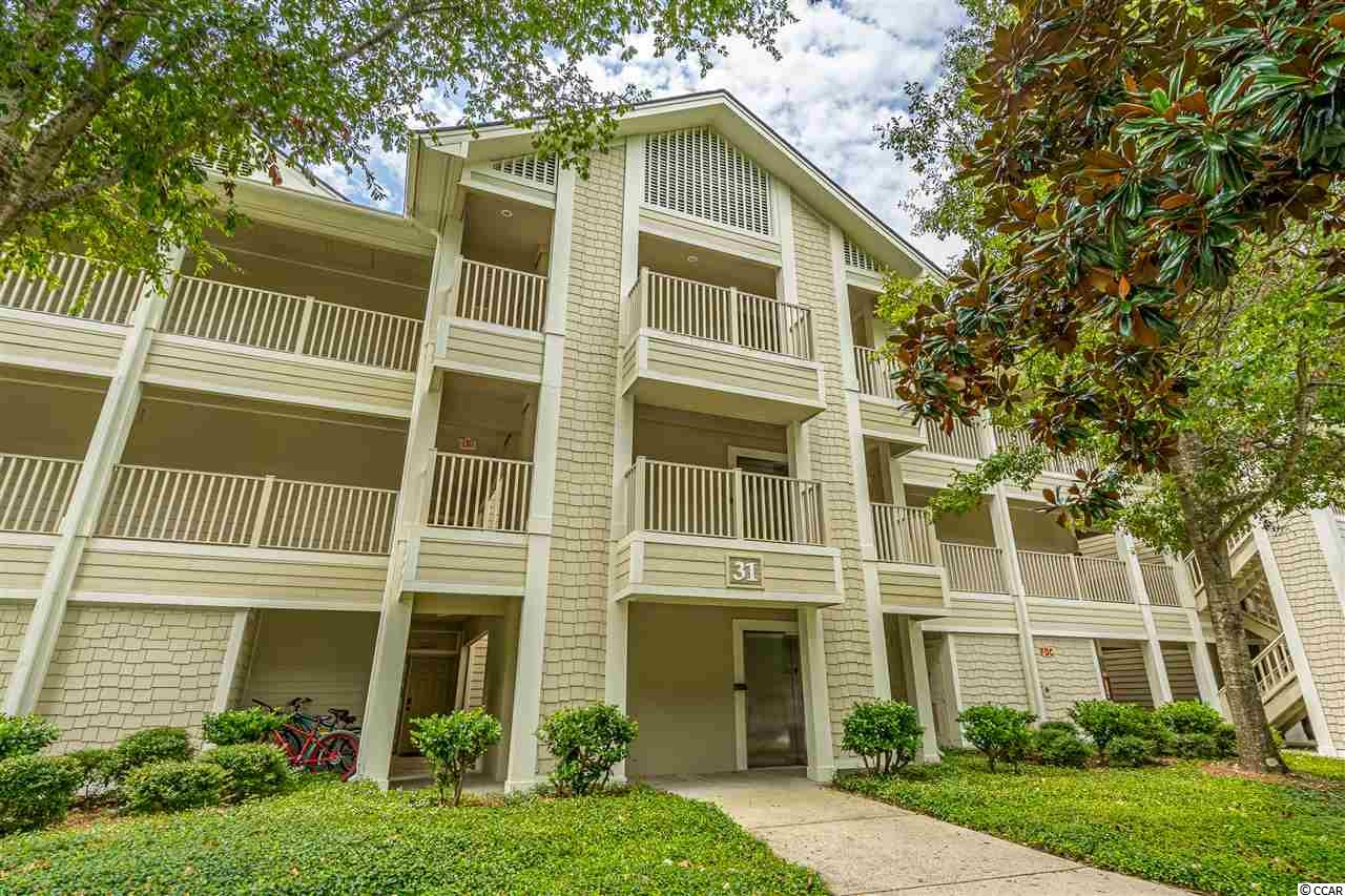 This unit has the wow factor you are looking for. Professionally redone from top to bottom in 2017. All popcorn has been removed from ceilings, new paint,  ceiling fans, light fixtures and window treatments. The white cabinets in the kitchen are set off by the granite countertops and top of the line GE Adora appliances. There is a breakfast bar with stools for casual eats and a large dining area. The living room has a large bump out window flanked by two side windows that look out to the tree tops and driving range. Sliders will lead you out to the screened porch with fresh carpet and paint perfect for morning coffee or afternoon drinks The master suite also allows access to the porch thru a wall of sliders. The master bath has been completely updated from floor to ceiling including a soaker tub and new double vanity. The second bedroom is currently used as an office but features a sleep sofa and access to the hall bath. The stackable washer and dryer was installed in 2017 and there is a large lockable owners closet in the hall. All this located on the top floor with elevator access. Tidewater is a gated community that offers a host of amenities and is conveniently located close to the beach.