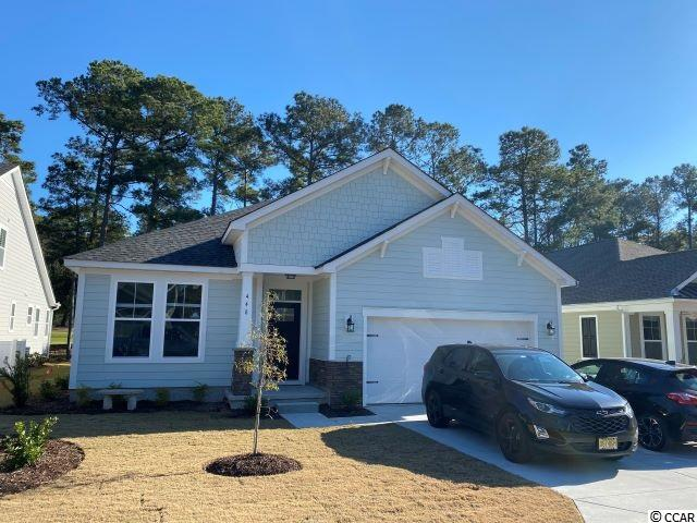 This Southwind floor plan home is located on the 16th fairway at TPC Myrtle Beach. There are very limited opportunities remaining to own a home in Champions Village. This house is loaded with upgrades including a deluxe kitchen with stainless appliances, a fireplace, tray ceilings in the owners suite and family room, upgraded cabinets, a farm sink, quartz counter-tops, and much  more. Don't let this home get away!