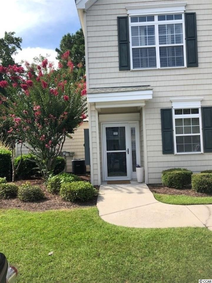 This townhome style property is loaded with charm and is being sold furnished! Meticulously maintained and never rented. As you step inside the Foyer, there is a half-bath immediatley to your right. It has a window for natural light and also a closet. The Kitchen is equipped with slate GE Appliances that are 4 years old. The breakfast bar separates the dining area and living room. From the living room you'll find sliding doors leading to a 10x10 covered patio. On each side is attached storage. The patio offers a beautiful view of green grass and a tree line for additional privacy. The washer/dryer connections are on the first floor with shelving. The 14x14 master bedroom is located on the 1st floor and offers double windows overlooking the common area green. All windows are complimented by Plantation Shutters and 9' ceilings throughout. There is a large walk-in closet, spacious master bath offering a shower with seating. The doorways to the master bedroom and bath are wide. Upstairs you'll find a large loft area which is used as a 3rd bedroom with a closet, double windows for more of that natural light. The other bedroom measures 14x12 and you'll find more double windows for light overlooking the back green common area as well as two closets leading to the Jack & Jill bath The upstairs bath has a shower/tub and large vanity. This home has 7 closets so you'll have plenty of storage space. Village @ Glens is just minutes to the Little River Waterfront, beach,  dining, shopping, award winning golf courses, entertainment, medical, fishing and all the Grand Strand has to offer! Don't let this one slip away!
