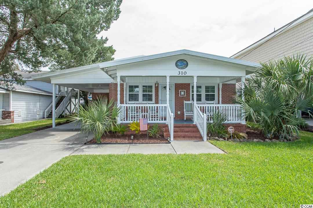 No HOA only 2.5 blocks from the beach.  Single level all brick home in the Cherry Grove section of North Myrtle Beach.  Home has been completely renovated including complete kitchen remodel, remodeled bathroom, new flooring throughout, new appliances, paint, new furniture, etc.  Home also features a carport which is perfect for both cars and golf carts as well as a large screened-in porch in the back.  Separate storage area attached to back of home with doors big enough to store your golf cart, beach chairs, grill and so much more.  Move-in ready.  Located in the heart of Cherry Grove on only a short distance from area attractions, shopping, dining, entertainment, golf, the sandy beaches and so much more.  Contact Eric today to schedule your private showing!