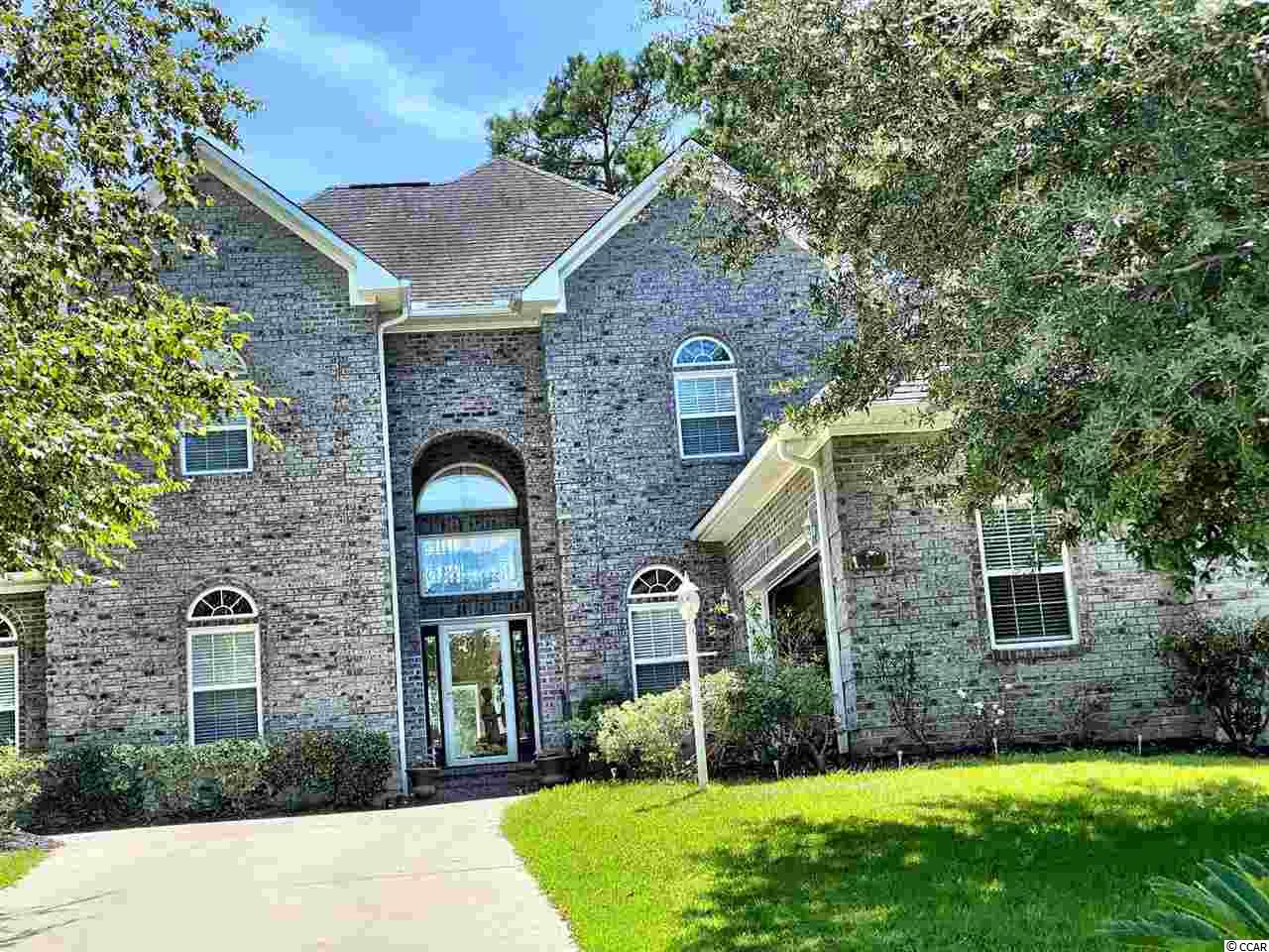 Beautifully designed, custom built, all brick home in the Prestigious community of River Hills.  This 4 bedroom, 2 and a half bath home overlooks the 18th Green, fairway and clubhouse.  The formal entrance opens up to a 2 story great room with fireplace and a wall of glass windows, showing casing the open balcony with views of the River Hills Golf Course.  Attention to detail is apparent throughout this home  with crown moldings, bamboo flooring and much more! Fully equipped spacious chef's kitchen.  Master suite is on main level of home and offers plenty of closet space with built ins, walk in custom shower and tub.  Home sits on a high, well manicured, estate lot with lots of shade trees.  This immaculate home shows like a model and will not last long!  River Hills is an established Golf Course Community, located in the heart of Little River , offers a beautiful setting for peaceful , private Southern Comfort.