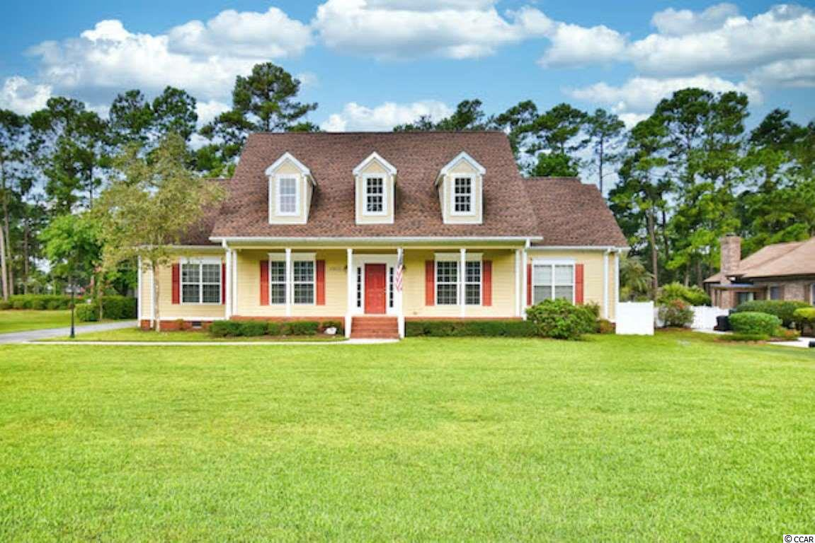 Welcome home to this beautiful low county style home with 5 bedrooms, 3 1/2 baths on one of the Myrtle Beach National golf courses in the lovely community of Southcreek! This home features a large open living area with plenty of natural light and picturesque golf course views, a modern kitchen with Corian countertops, a breakfast nook by the fireplace and luxury vinyl flooring, and a wonderful outdoor living space with a covered porch, sunny patio area and private fenced yard. There are two first-floor master suites, each with a private ensuite bath and walk-in closets. The main master bath includes a large whirlpool tub. The third bedroom on the first floor has access to the half bath. The second floor delivers another huge living space, including a second kitchen with granite countertops, two large bedrooms with access to the third full bath, and a bonus room that could serve as a game room or even a 6th bedroom. The second floor has infinite possibilities, from a mother-in-law suite to an office and entertainment room. Special features include an outdoor irrigation system, a 100-gallon underground propane tank and an encapsulated crawl space. Southcreek residents enjoy fine amenities including a pool, clubhouse, tennis, and shuffleboard courts. The award-winning Myrtle Beach National's signature Arnold Palmer golf course features three different courses and memberships available. The location provides easy access to major roads, just a short drive to the beach and all the shopping, dining, and entertainment the Grand Strand has to offer!
