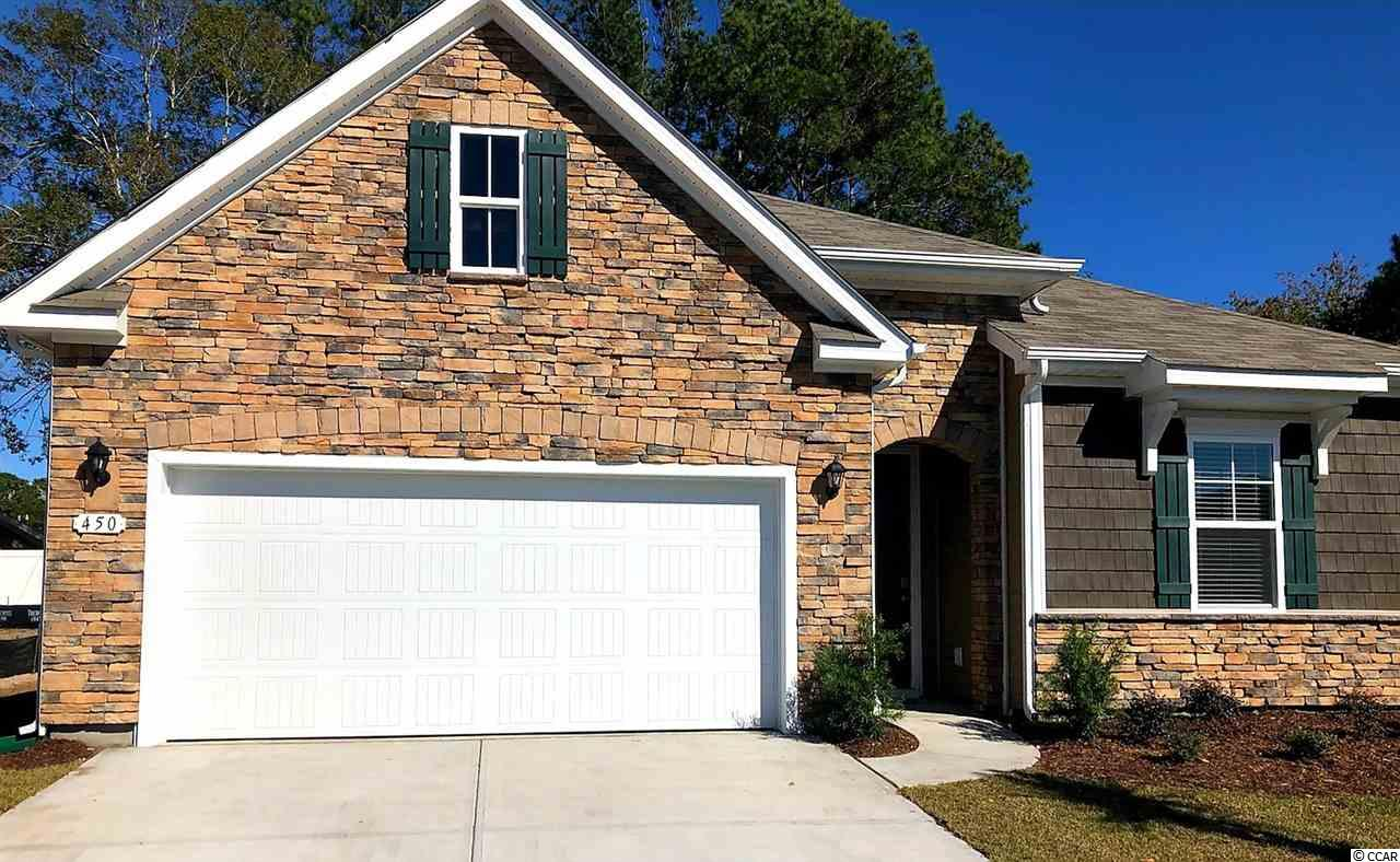 """This popular Acadia plan features a beautiful exterior with stacked stone and shake accents. Open interior design with 9' ceilings and a great definition of space. The well appointed kitchen will include granite countertops, 36"""" white painted cabinets, and stainless Whirlpool appliances. The home also offers a rear covered porch which is great for morning coffee! The split bedroom plan creates a private owner's suite with lots of natural light, a walk-in closet, and a spacious en suite bath. This is America's Smart Home! Simplify your life with a dream home that features our industry leading smart home package allowing you to control the thermostat, front door light and lock, and video doorbell from your smartphone or with voice commands to Alexa! It's a home that adapts to your lifestyle. Located approximately 1 mile to the beach in a golf cart friendly community! Approximately 4 miles to Market Commons and less than 6 miles to the Murrells Inlet Marsh Walk.  *Photos are of a similar Acadia home. (Home and community information, including pricing, included features, terms, availability and amenities, are subject to change prior to sale at any time without notice or obligation. Square footages are approximate. Pictures, photographs, colors, features, and sizes are for illustration purposes only and will vary from the homes as built. Equal housing opportunity builder.)"""