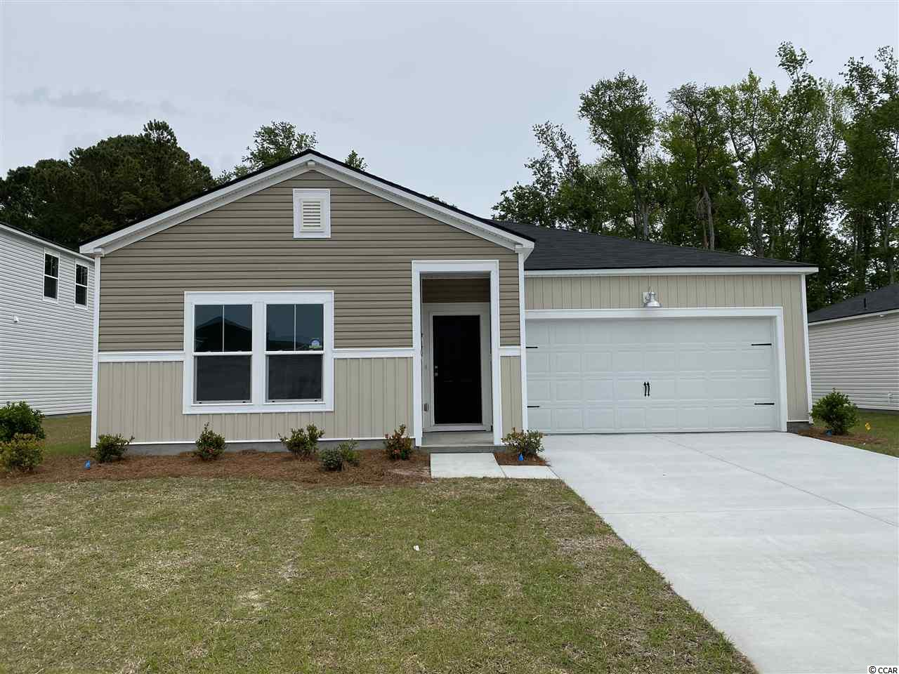 "These pictures are of a ""Similar Home"", it is a MODEL home with extra options.  Beach Village is our newest community located in Deerfield. This Dover is 3 bedroom 2 bath. This home features Granite kitchen countertops with subway tile. Stainless steel appliances and Laminate flooring. A gas community with a tankless water heater and gas stove. Low HOA"