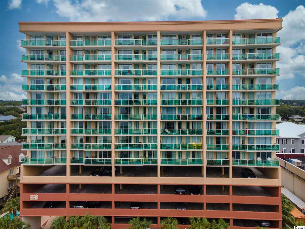 Now's your chance!  One of the largest, furnished one-bedroom units you can find in North Myrtle Beach in the highly desirable Malibu Pointe is now available!  Featuring tile floors, granite kitchen countertops and tile backsplash, this one should get your attention! Could this be your first beach property?  Maybe it's the perfect weekend getaway condo!  Isn't it time to consider a rental property?  This cheery coastal cutie could be all that and more!  Full of amenities, you can stay busy all day with an exercise room, indoor pool, lazy river, hot tub and game room.  Take a few steps across Ocean Drive and your toes are in the sand or maybe you'll try your hand at parasailing lessons!  Enjoy a bite and brew at the oceanfront Molly Darcy's Irish Pub but save room for a soft serve ice cream from Mr. G's!  It's all right outside your door! Square footage is approximate and not guaranteed. Buyers responsible for verification.