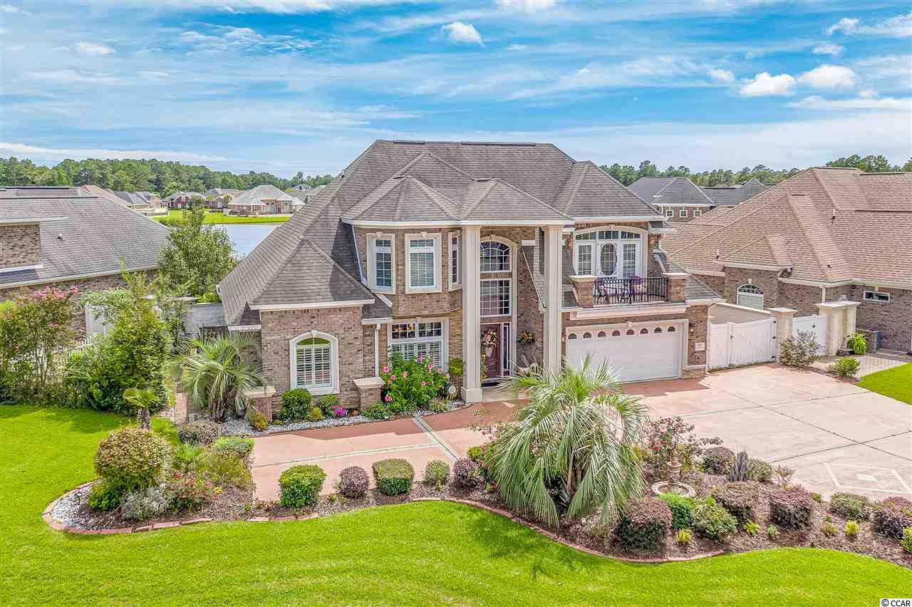 Welcome to the hidden gem in Little River, located in the Waterfall community. This Oasis floor plan is stunning! The backyard and views of the lake are exactly heaven on earth. This custom all brick split floor plan features three bedrooms and four full bathrooms. The first floor features the main master suite and master bathroom, the dining room, living room, kitchen, laundry room, the den and another full bathroom that has direct access to the backyard. This property sits on over a quarter of an acre with direct views of the lake. The outdoor summer kitchen features granite tops and a gas grill with a spacious patio where you can comfortably entertain friends and family or simply relax in the hot tub. Upstairs, you will find two bedrooms with its own private bathroom and walk in access to the attic! This Oasis floor plan has plenty of extra closet space for storage plus so much more! Did I mentioned the side gated private parking space perfect for a golf cart or small water crafts? This beautiful home is only minutes away from shopping, dining, and Cherry Grove beach. You will be impressed with all of the upgrades and condition on this property. Schedule your showing today!