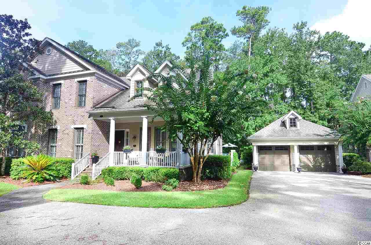 Welcome to 407-B Tuckers Road in Pawley's Island's sought-after Litchfield Plantation community. If you are seeking a luxury townhome in a community with abundant amenities, then look no further. This 4-bedroom villa has plenty of room for full-time living, but would also make a wonderful second home at the beach. As you enter the home, you'll notice beautiful wood flooring throughout the ground level along with plantation shutters throughout the living and dining rooms. The kitchen has stainless appliances, a gas cooktop, granite counter tops, a custom backsplash and modern white cabinetry. The living room is very spacious with vaulted ceilings, built-in cabinetry, plenty of natural light and a gas-burning fireplace. The owner's suite is located on the ground level and has a large bathroom with a tiled shower, his/hers sinks, and a soaking tub. As you head upstairs, you'll find 3 additional bedrooms and a bonus landing area that could be used as a sitting area, game room, media room or play area for children. With its vaulted ceiling and private full bath, the larger of the upstairs bedrooms could easily serve as a second owner's suite. The home has porches in the front and rear, with lots of room for relaxing, grilling and taking in views of the nature preserve out back. In warm months, owners can enjoy one of the most picturesque community pools in Pawleys Island, which is situated along the marshes of the intracoastal waterway. And if you are headed to the historic Pawleys Island Beach for a day in the surf, you will have exclusive access to Litchfield Plantation's private oceanfront beach house for parking and use of the facilities. Don't miss this opportunity to call Litchfield Plantation your home!