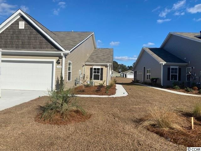 """Lovely, low maintenance, paired ranch home in a brand new community! This Tuscan floorplan offers a spacious, open layout all on a single level. With vaulted ceilings, tons of natural light throughout the living and dining areas, large kitchen island, and spacious covered porch, this home is perfect for entertaining! The kitchen also features granite countertops, stainless steel appliances, 36"""" white painted cabinets, and large pantry with ample storage. Roomy owner's suite with walk-in closet and private bath with dual vanity and 5' walk-in shower. This home also features laminate wood flooring in the main living areas, tile in both bathrooms and the laundry room, a tankless water heater, and our Home Is Connected smart home package. Yard and exterior maintenance are all covered! 4' black aluminum fencing is permitted (per HOA approval).  *Photos are of a similar Tuscan home. (Home and community information, including pricing, included features, terms, availability and amenities, are subject to change prior to sale at any time without notice or obligation. Square footages are approximate. Pictures, photographs, colors, features, and sizes are for illustration purposes only and will vary from the homes as built. Equal housing opportunity builder.)"""