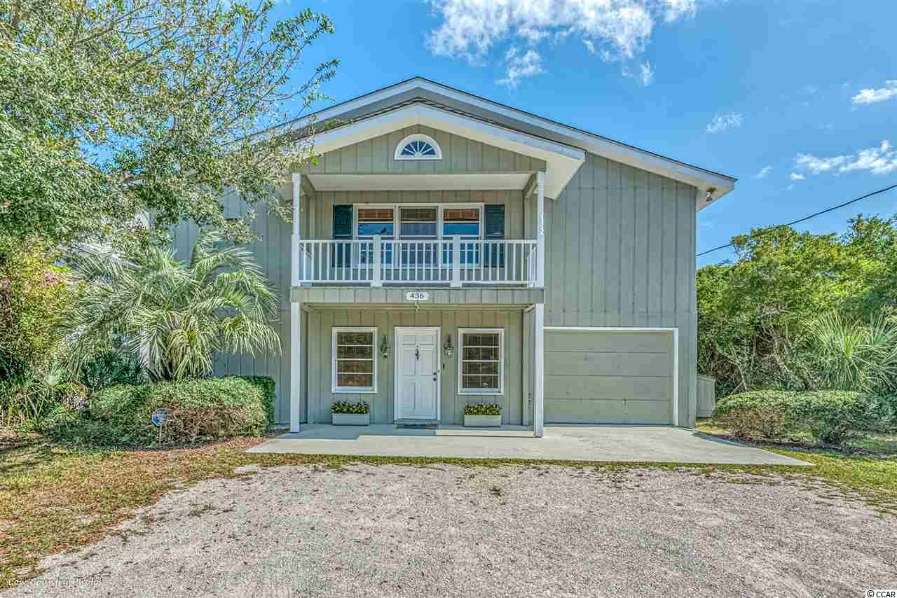 436 Parker is located ocean front in the heart of North Litchfield Beach in the area of historic Pawleys Island, SC. The home is nestled among the dunes on a huge beach front lot surrounded by trees and landscaping; creating a private enclave that complements its convenient, central location. The design of the home provides a main floor with a spacious, open living area flowing to a sweeping porch overlooking the beach and Atlantic. Anyone looking for a beach home that allows abundant space for cooking, sipping, dining and good times will be delighted with 436 Parker. The main floor features 4 bedrooms and 2 ample baths; with two bedrooms opening to the ocean front porch and beach. The entry level floor is the perfect space for kids and teenagers with two additional bedrooms, large rec room, laundry and tons of storage...plus another ocean side porch. Great rental history. 436 Parker awaits with best in ocean front living at North Litchfield, conveniently located 20 miles south of Myrtle beach and 60 miles north of Historic Charleston SC.