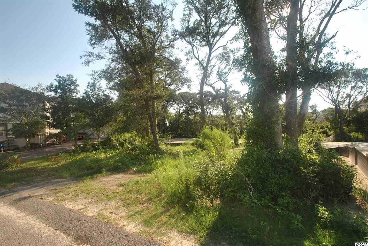 Only a block and a half off the beach! Build your home outside of the designate flood zone. Great privacy. This homesite backs up to protected wetlands. Easy walk to the beach. NO HOA!
