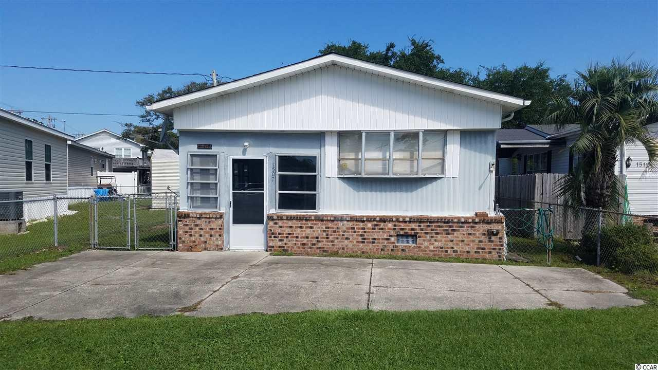 What a wonderful little beach getaway. This affordable cottage is less than a half mile away from the shandy shores of Garden City Beach. Quiet street with no HOA. Many upgrades over the years. Nearly brand new HVAC system. This home feature a separate in-law suite that has its own bathroom and separate entry door. Yes, you own the land here, NOT leased. This would make a great family beach home , or, an excellent little rental with dual suites.