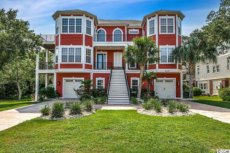 Amazing ocean views from this bgorgeous custom built home just  steps from the beach in the prestigious neighborhood of Tilghman Estates in North Myrtle Beach.  You will love the exquisite detail throughout this 6 bedroom 4.5 bath home.  Home features include ceramic tile throughout, carpet in bedrooms, 3 floor elevator that is handicapped accessible, decks surround each level with screened porch areas.  Spacious  gourmet kitchen with large island, marble counters, custom cabinets, twin dual stainless steel refrigerator and freezer, and double dishwasher. Top floor living area boasts a corner gas fireplace with marble inlays, surround sound and spectacular ocean views! Natural light flows through the over 4000 heated sq.ft.  Sunbath on the roof top deck while enjoying incredible ocean views and breezes.  Large private backyard if fully fenced with tall mature trees providing shade, while a lush courtyard and patio leads to a large in ground heated pool and outdoor shower.  This home truly has it all so don't miss out on your opportunity! Tilghan Estates is close to everything North Myrtle Beach has to offer and is a short golf cart ride away from restaurants, shopping, Main St., entertainment and much more!