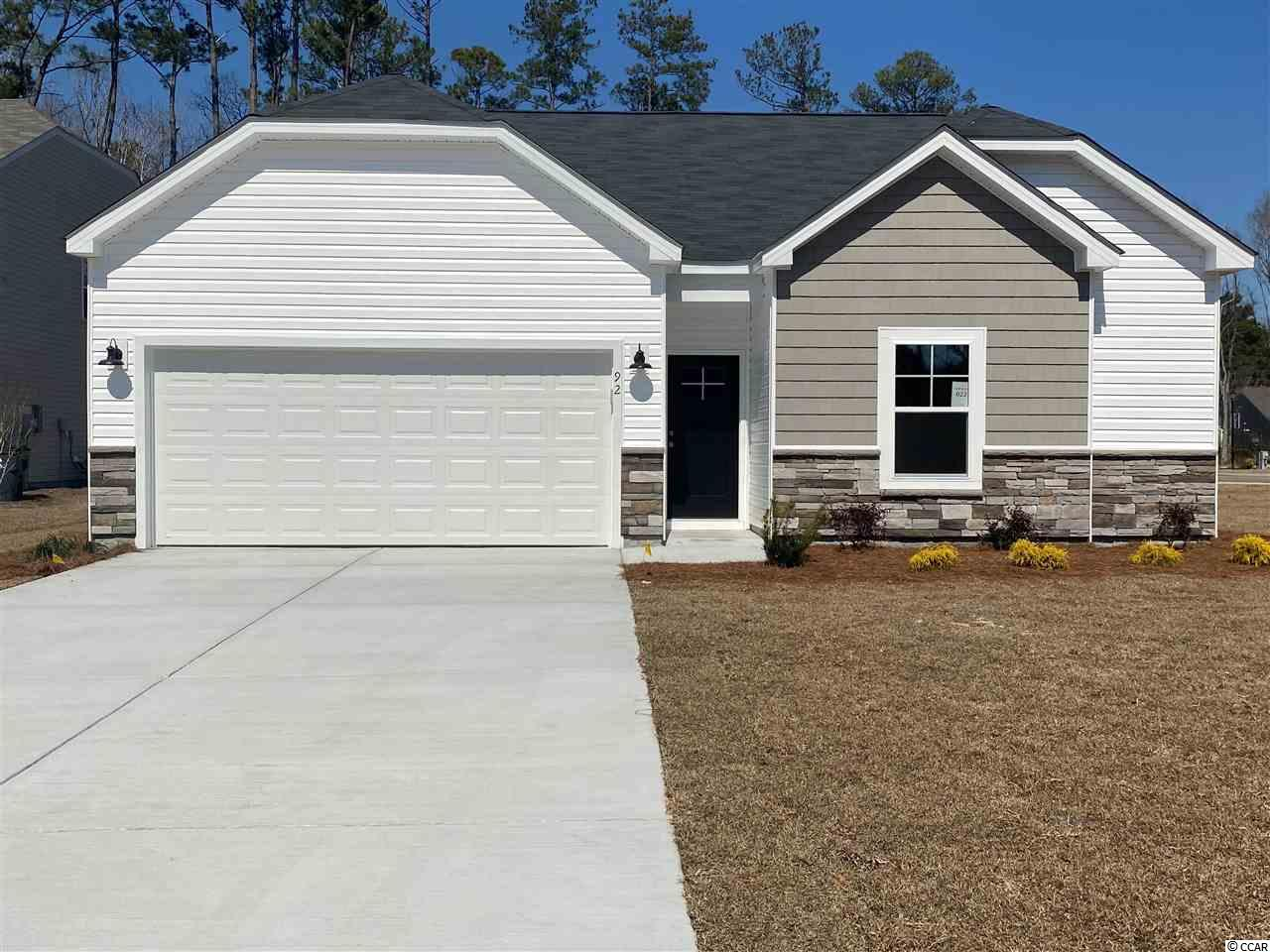 """This is the Patriot plan in the sought after community of Pawleys Cove, options and upgrades will vary as built. Pawleys Island is a famous seaside historic town known for it's carefree and laid back style with unspoiled beaches, eclectic dining, and challenging world-class golf gourses galore!  There's also great amenities close by to enjoy like bike trails, community parks, natural gardens, and local creeks for crabbing and fishing.  Pawleys Cove will be a great place to make your memories happen.  This is the """"Patriot"""" plan and this home is ready to move in!!  It features an open concept family, dining and kitchen area and the laundry room is just off of kitchen with a linen closet.  Great storage in this home with all bedrooms having walk-in closets!  It features gorgeous vinyl plank flooring throughout main and wet areas as well as owners suite. The kitchen features """"Bisque"""" painted maple cabinets, granite, stainless upgraded appliances and a large entertaining island with gorgeous pendant lighting! The Owner's bath  features a large tile shower and double vanities with a linen closet.  All information is deemed reliable but not guaranteed.  Buyer is responsible for verification.  Some pictures in this listing are of a similar home and not the actual home and furniture is for staging purposes only."""