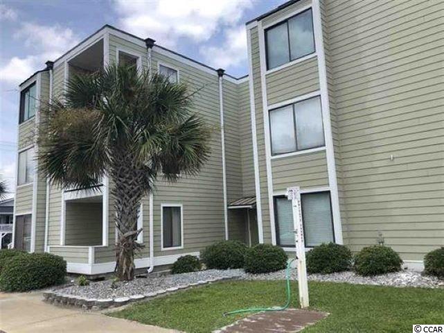 Savor the Sun at Marsh Villas in Cherry Grove. This second row condominium is ground floor with parking outside and an easy access.  This two bedroom, one and a half bath is move-in ready and is sold furnished.  The Master bedroom has a king sized bed and the guest room sleeps four with a queen bed and a set of bunk beds.  Clean and tastefully decorated, it is a perfect place to make memories or use as a rental property.  This unit has not been rented for the past 18 years except to family and friends.  Just painted, white kitchen cabinets and appliances with breakfast bar is accented with tiled backsplash and opens to the living area which faces the balcony across from the Ocean.  A coin laundry is located on the second floor for owner's use.  You'll enjoy the private pool, just adjacent to the building.  Low Home Owner dues include Flood Insurance.  Maintaining this property is easy...all floors have been recently tiled.  The HVAC was replaced in 2016 and the water heater in 2018.  Your Beach chairs,, etc. can be stored in the storage area just inside the front door.  Relax in the evenings on the out front balcony of your condominium and listen to the sound of the Ocean....so relaxing.  Access to the Beach is just across the street with a path that takes you over  the sand dunes and ocean front.  Easy to See.  HOA allows Owner pets only.  Two pets, limit 50 pounds each. Square footage is approximate and not guaranteed. Buyers responsible for verification.