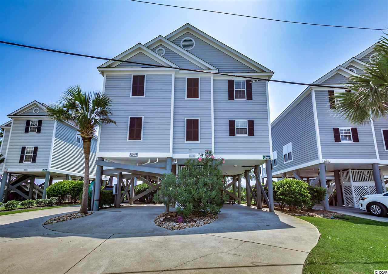 1414 North Waccamaw Drive is situated oceanfront within the Portofino I community that encompasses ten homes, pristine landscaping, a massive heated community pool, and a private beach walkover. Less than one mile north of the Garden City Pier and iconic downtown of Garden City Beach, you're close enough to the action but far enough away for peace and quiet. The well-maintained home has four bedrooms, four full bathrooms, and 1768 heated square feet. Unique to this community, the owner installed additional windows on the oceanside living room with LVP (luxury vinyl plank) flooring, a sundeck, and a fourth bathroom giving each bedroom a private bathroom. Three of the bedrooms are oceanfront and have walk-in closets. There is parking for four cars, including two covered, exterior storage, and a large enclosed outdoor shower. When entering the home, you'll find a well-appointed interior that sells completely furnished. The main level features an open concept with a large living and dining room, kitchen, laundry room, and bedroom with bathroom. Off the living room is a covered porch and sundeck with direct access to the ground level leading to the beach and pool. Upstairs there are three more bedrooms and bathrooms. The master suite even has a private covered oceanfront balcony. If you're seeking an oceanfront home in the Myrtle Beach area, this is an opportunity to own a turnkey home with built-in rental income, a heated pool, and for much less than you'd expect. Why continue to rent when you can purchase your own beach retreat. Make sure to check out the Matterport 3D Virtual Tour. It's like you're walking through the home. Link to the virtual tour: www.bit.ly/1414Portofino