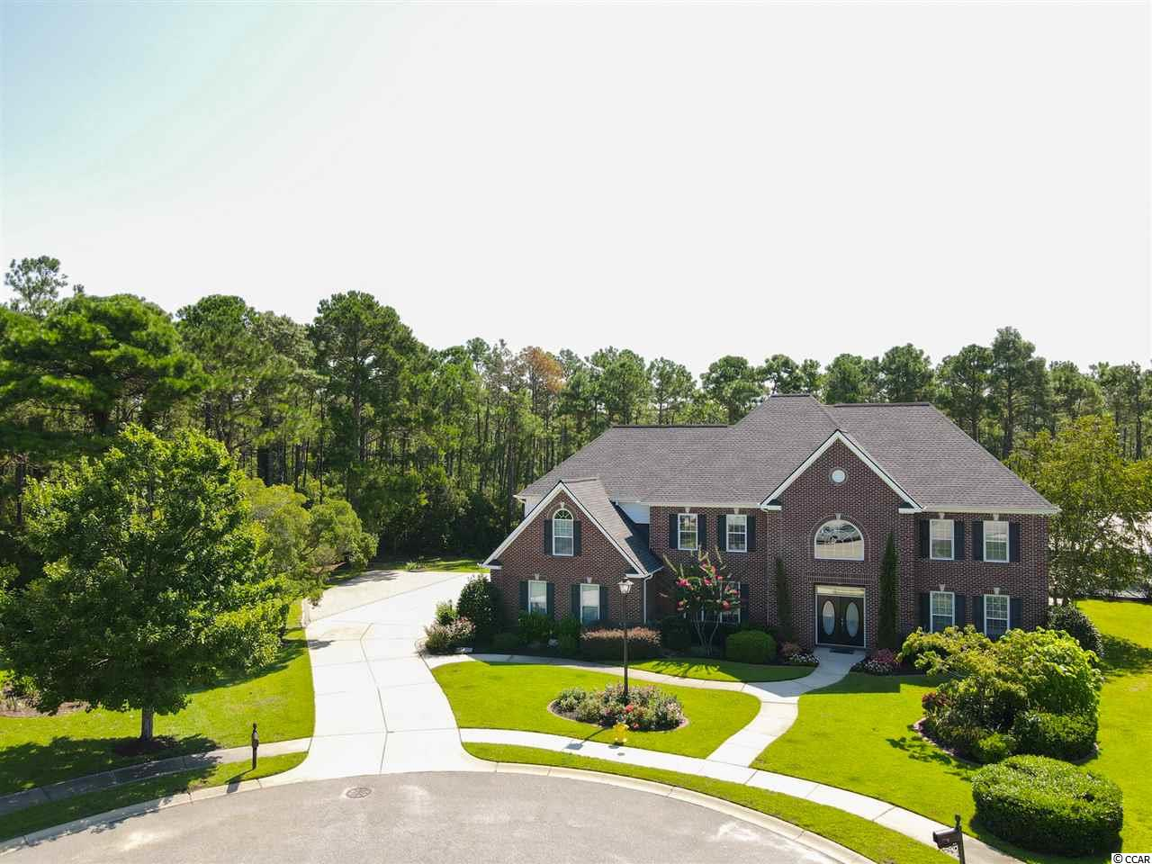Spacious 6BR/5BA home with a 3 car garage on a quiet cul-de-sac backing to a protected reserve area in Waterford Plantation.  The double lot offers tons of privacy and has an enclosed saltwater pool with slide and water feature, in ground hot tub, fire pit, and outdoor kitchen with granite countertops.  As soon as you enter you will notice the impressive size of every room in this 5200 square foot home.  Kitchen was renovated in 2018 and includes stainless steel appliances, granite countertops, tile backsplash, and large breakfast nook.  Behind the double doors of the spacious master suite you will find tray ceilings, large walk in closet, double sinks, whirlpool tub, and shower.  Three of the bedrooms on the second floor also have en-suite bathrooms.  Other features include high ceilings in the foyer, formal dining room, an oversized driveway with plenty of parking, and the screened porch has all season windows for year round use.  Roof was replaced in 2016.  HVAC units replaced in 2015.   Community amenities include tennis courts, basketball court, and pool.  Great location with easy access to Highway 501 and Highway 31.  Close to shopping, golf, dining, and just 15 minutes to the beach.  All information is deemed reliable but not guaranteed.  Buyer responsible for verification.