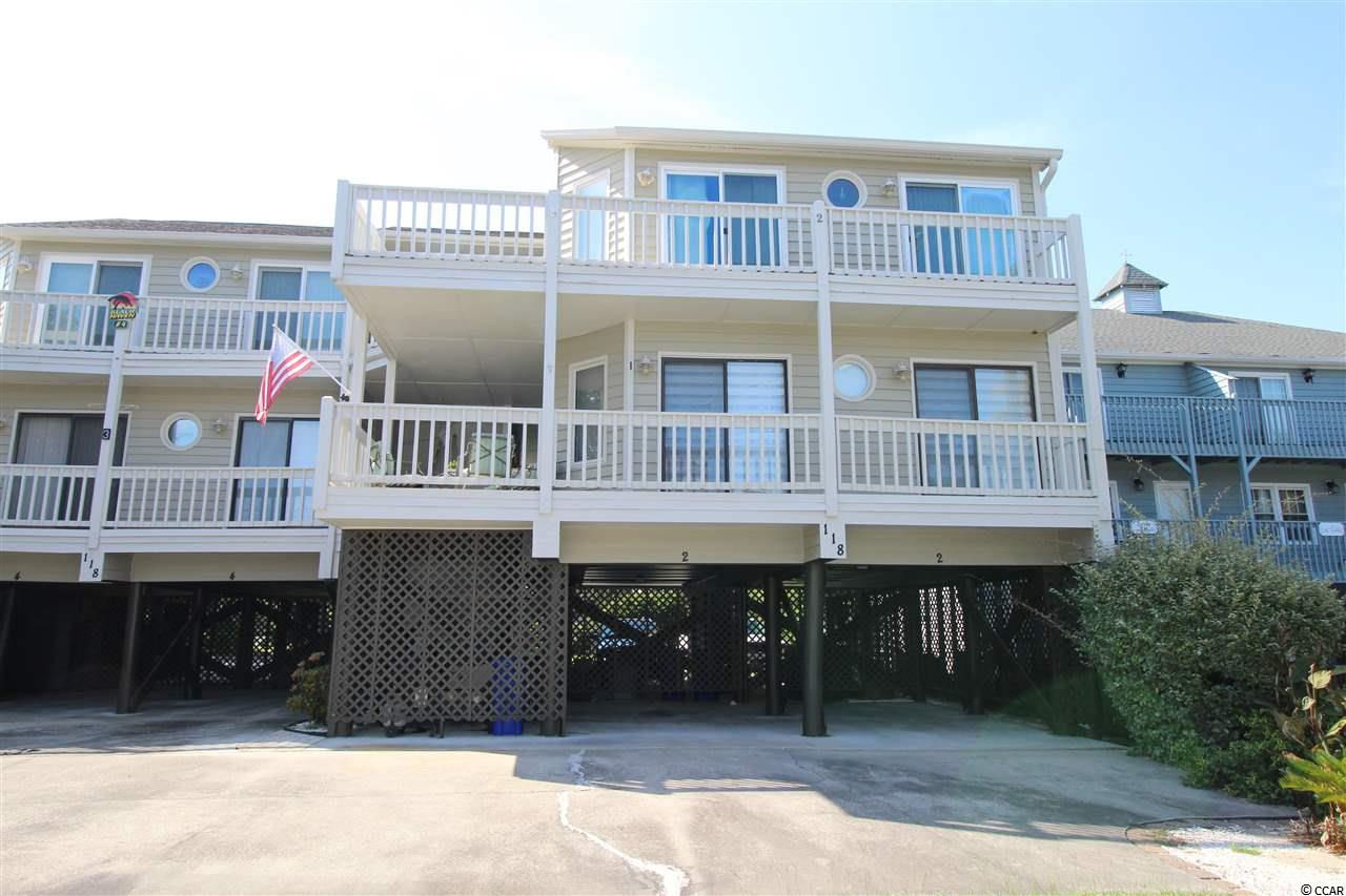 Welcome to Surfside Beach...THE FAMILY BEACH!  This Tastefully Updated Condo Is Located 2 Blocks From The Glistening Blue Water of The Atlantic Ocean.  2 Beds, 2 Baths, Top Floor Unit.  The Kitchen, Baths & Flooring Have Been Tastefully Updated With Quality Finishes Over The Past 5 Years.  Kitchen Now Features Granite Tops, All Stainless Steel Appliances, Double Oven, Pantry Cabinet, Tile Backsplash, Tile Floor & Stainless Steel Farmer's Sink.  Quality Hardwood Flooring Is Found In The Hallways & Living Areas.  Take Your Pick Of Outdoor Living In The Front Or Rear Of The Private 2nd Floor Decks.  The Rear Deck Features A Retractable Sunsetter Awning.  The Outdoor Living Areas Are One Of The Highlights Of Willow Winds.  Another Major Highlight Is The MASSIVE Amount Of Storage Possibilities In The TWO DEDICATED COVERED PARKING AREAS UNDER BUILDING.  Bring Your Boat, Golf Cart, & Vehicles!  This Small Building Is Not Vacation Rented.  New HVAC 2018.  Being Sold Partially Furnished  (Living & Dining Furniture Will Stay, Which Includes Sleeper Sofa).  WILL....NOT....LAST...!