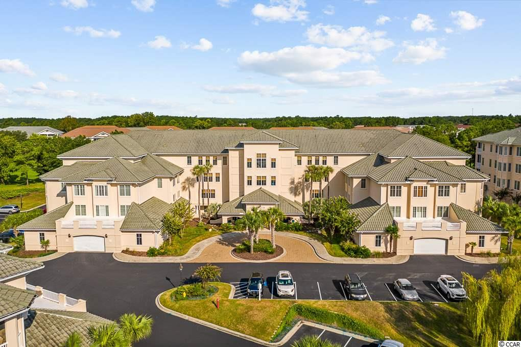 This is a MUST SEE!  This prestigious community is located within Barefoot Landing and sits right along the Intracoastal Waterway. Schedule an appointment to see this 3rd floor, 2 bedroom, 2 bath, almost FULLY FURNISHED condo, located in the GATED community of Edgewater.  The kitchen has granite countertops, stainless steel appliances, tile flooring, abundant counter space and cupboards and a breakfast bar. The laundry room has built in cabinets and a countertop, convenient for folding the laundry. The open floor plan features a living room that is framed by architectural columns and an arched opening that leads to the large dining area, adjacent to the kitchen. The spacious master bedroom has a tray ceiling with a ceiling fan and two walk in closets.  This condo has something that most units don't have and that is an EXTRA LARGE, beautifully tiled walk in shower and a LINEN CLOSET.  The second bedroom has built in shelving with a murphy bed and there's still enough room to make it an office or sitting area. The second bathroom has a tub/shower combo and is located off of the living area and adjacent to the 2nd bedroom. The private screened porch has tile flooring and a bar to sit at and watch the golfers as they go by. Recent upgrades include a new HVAC unit in 2016, new toilets and bathroom fixtures, remodeled Master Bath, all new lighting throughout and the microwave was replaced in 2019. There is an assigned parking space in the garage and another parking space in the outside parking lot.  A large storage closet located at the end of the hallway and another storage unit within the garage, gives you ample space to store your holiday decorations and more.  The HOA fee includes water, sewer, trash, building insurance, pest control once a month, common area electric, onsite property manager, elevator, common area maintenance, phone, cable, internet, dryer vents cleaned once a year, outside windows washed once a year, outdoor pool, fitness room and clubhouse.  You ha