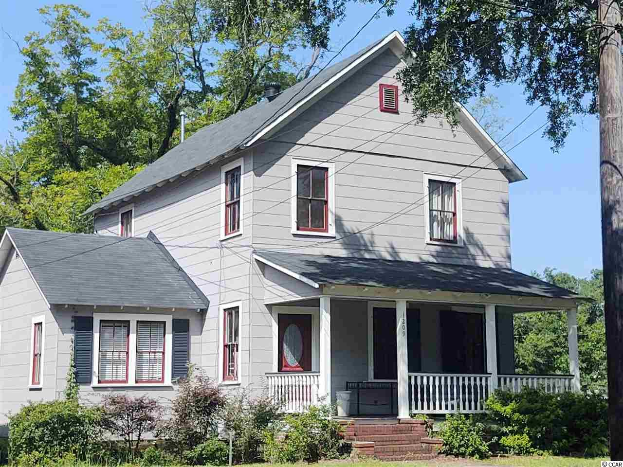 Welcome to 1209 Prince street located in the historic Walker Subdivision in Downtown Georgetown SC!  This large home was renovated within the past few years to include new wiring, plumbing, roof, 2 new HVAC's and more! Upon entering the front door, a gracious entry welcomes you into the home.    The first floor features large rooms with plenty of sunlight!  Beautiful hardwood floors take you from the entry, to the formal living and dining rooms, a den, and a first floor bedroom and bath!  Upstairs you will find 3 more bedrooms and full bath.   The kitchen is a large room with plenty of counter and cabinet space and a laundry/utility room off the kitchen. High ceilings are charming feature with a few of the ceilings in the home being beadboard. This home is located within strolling distance to the downtown shopping district.  Within a few blocks you will find not only shopping and dining, but  you will also have access to our five rivers via the East Bay Boat landing and kayak launch!   A great weekend home, full time residence, or rental!