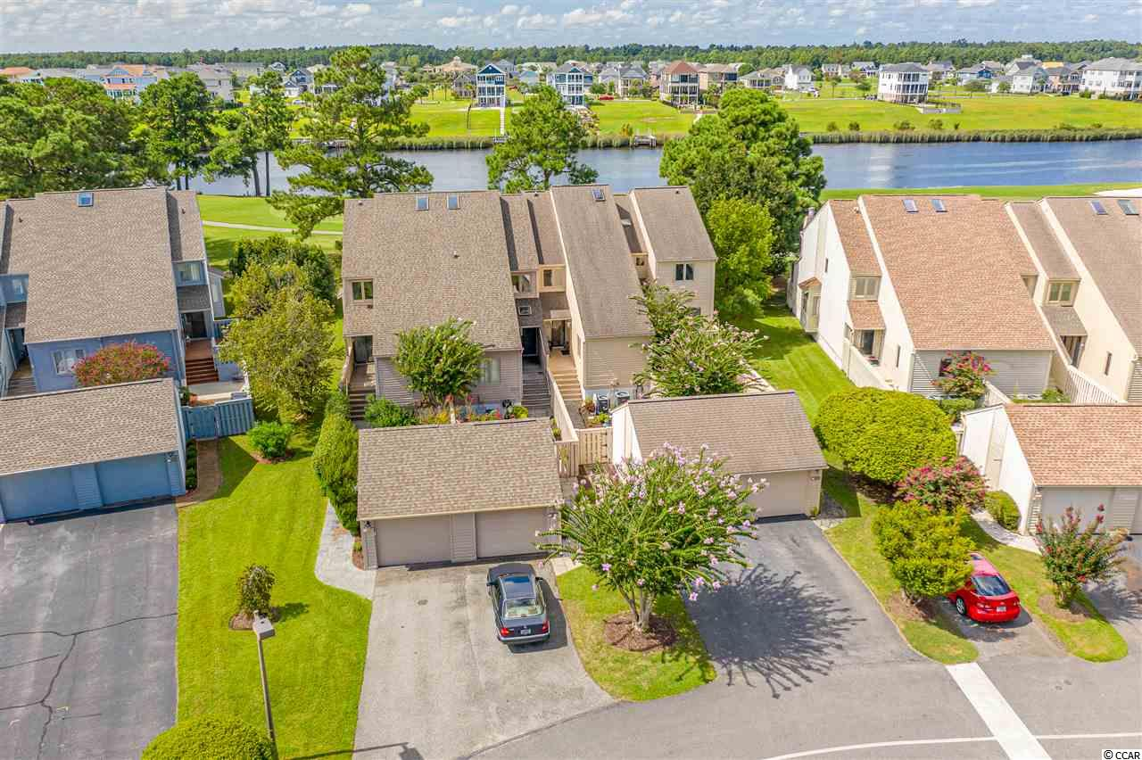 It's time for you to enjoy the views of the Intracoastal Waterway and the golf course from 4050 Fairway Lakes. This 2-story townhome features 3 bedrooms, 3 baths, great outdoor living space and a private 1-car garage.  This home has been recently updated (in 2019) with gorgeous hardwood floors throughout much of the first floor, paint throughout, new carpet, a new garage door and more.  The kitchen is bright and cheerful with white cabinets and stainless steel appliances.  The master suite upstairs has a beautiful balcony overlooking the waterway and golf course. Fairway Lakes has a community pool and tennis courts for the residence. This home has amazing sunset views from the back porch overlooking the waterway.  Enjoy!