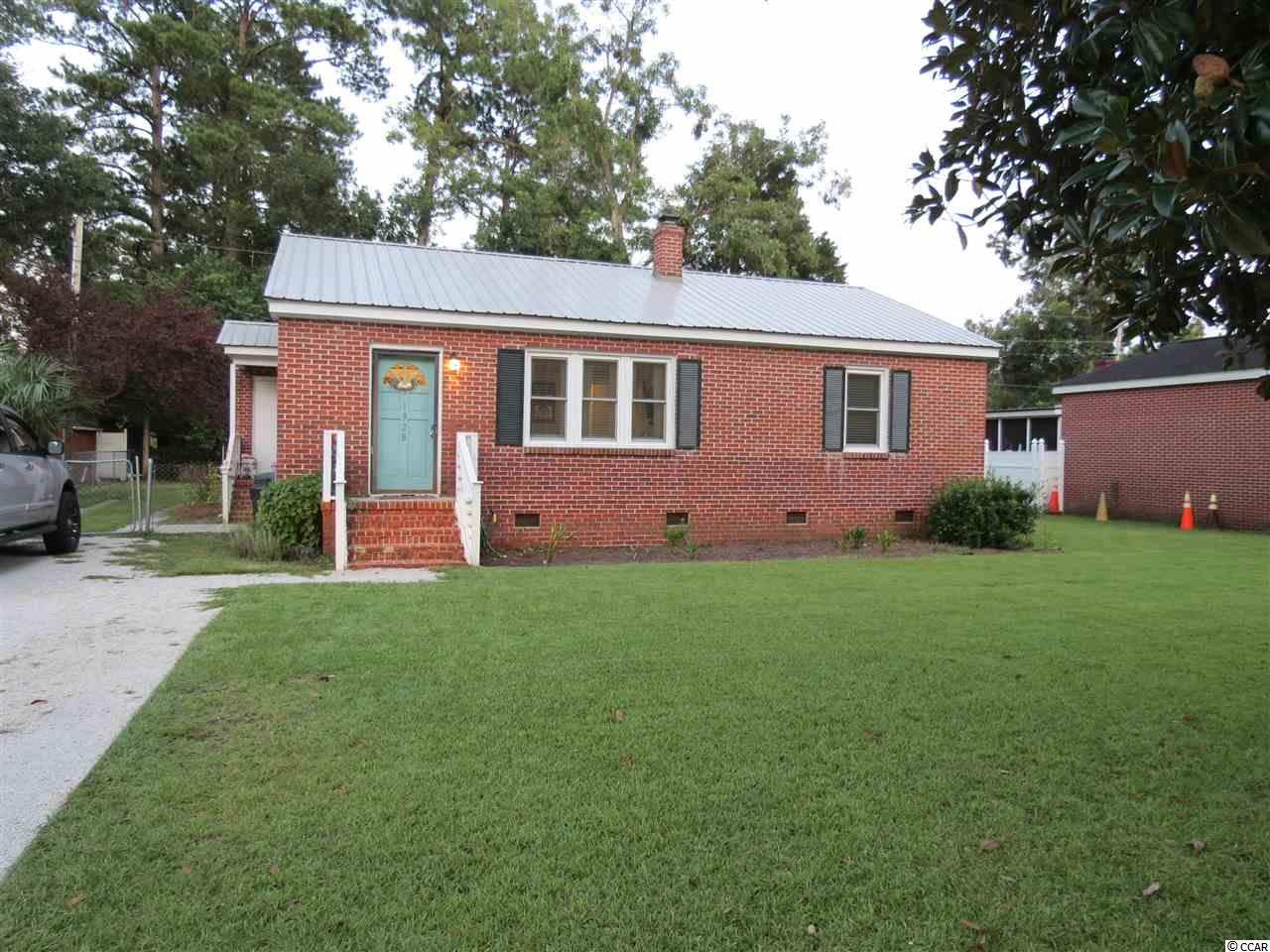 """This one I call """"Cute as a Button"""" and is in move in ready condition. Kensington Estates is a very desirable neighborhood with a top rank Elementary school and conveniently located close to town. This adorable all brick veneer home was completely remolded in 2018 and offers many of your upgrades including  a tankless hot water heater, all vinyl windows and a tin roof that was installed in Nov. 2019. Completely remolded kitchen with white soft close cabinets, subway tile backsplash, wall mounted chimney-style stove vent, Stainless Steel Frigidaire smooth top range, dishwasher and refrigerator and tile flooring. Remolded full bath with porcelain tile flooring, double vanity sinks and an added storage cabinet. Other features include new light fixtures in 2018, oak hardwood flooring through out the living space and bedrooms, crown molding, recess lighting, arch foyer entrance, attic storage, outside storage space and fenced back yard."""
