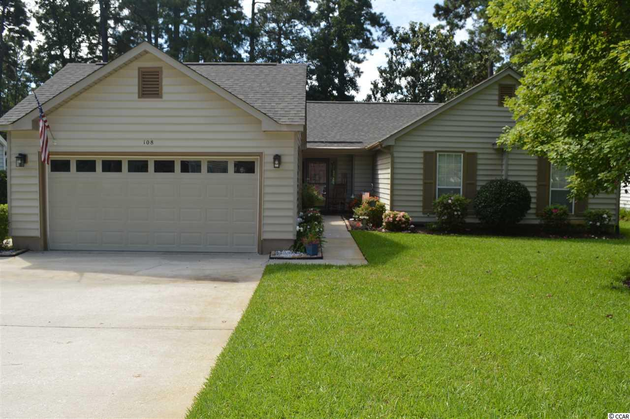 """This lovely immaculate move-in condition home sits on a pretty landscaped lot in the very desirable ADULT community of Woodlake Village. If you are a beach lover, you will be thrilled to know, that the blue Atlantic is less than 3 miles away. This is the """"Fairmont"""" floor plan and it has the openness and easy traffic flow from the kitchen and living/dining room that  provides the perfect spacious and entertainment area which you will love! As you enter, you are greeted by a high vaulted ceiling in the large living room with a  cozy wood burning fireplace which so much charm to this area. The one sided fireplace separates the living room  from the dining room which is a great feature!  Beautiful  wood-look laminate flooring in all rooms except bathrooms. If the family chef likes a big kitchen with lots of great cabinet, counter space and spot lightening here it is! Kitchen was completely remodeled nine years ago and features attractive cream-colored cabinets, work island and counter tops that have that granite look but are much easier to maintain. Newer appliances and a delightful  breakfast nook complete this amazing kitchen! A slider from the dining room leads out to a large and very inviting Carolina room with a new heat/air split system. Beautiful wood-look laminate flooring in this room- 3 years old. Also there are  attractive custom double blinds, one for privacy and one for shade,that are operated by  remote control are on all windows except French door and these are  another great feature of this room that make it so appealing.   Master bedroom is spacious and has walk-in closet. Master bath has a beautiful glassed walk-in tiled shower with seat which you will appreciate. Second and third bedrooms are also generous in size. Roof – 1 year-HVAC-3 years. New top of the line front  storm door. Living room slider- 3 years. New gutter guards. Home has vinyl siding and soffits which makes it so easy to maintain! All outside trim on home as some interior rooms in home"""