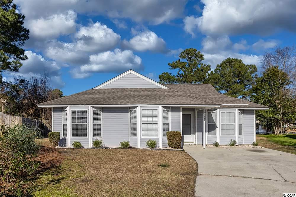 This is a very nice 3 bedroom, 2 bathroom home on the pond with wonderful water views. This home is a split bedroom plan with vaulted ceilings in Living Room, Sky lights, built in Bar, Bay Window and a slider door to the Patio. The Dining Room has beautiful chair rails and wainscoting.The Master Bedroom has walk in closets and a slider door going out to the back patio. This home has recently been improved with a new roof, new carpet, new interior paint, ceramic tile in kitchen and bathrooms and has many new fixtures. Enjoy water views from the Living area and back patio w/attached storage closet. Great central Murrells Inlet location-close to beaches, shopping, dining and hospital. Cute and Cozy A MUST SEE!!
