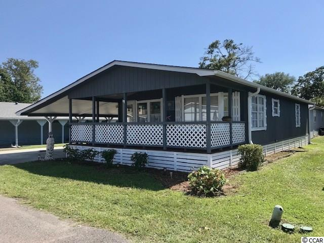 This 2 bedroom 2 bath beach style home is situated on a large lot on  one of the nicest streets in Oceanside Village.  A double driveway, cement that wraps 3/4 around this home  making this very easy to maintain a beautiful property.   Shed doors located on the side of home giving you plenty of covered outdoor space. Golf cart will convey with home.  Underneath this home is clean, clean, clean. Duct work is not sitting on ground or the insulation hanging.   Extra LARGE closet located in master bedroom.  French doors in the master bedroom leading to small deck for privacy away from family or house guests :)  Mattresses in both bedrooms only 1 years old.  Home come furnished and decorated.