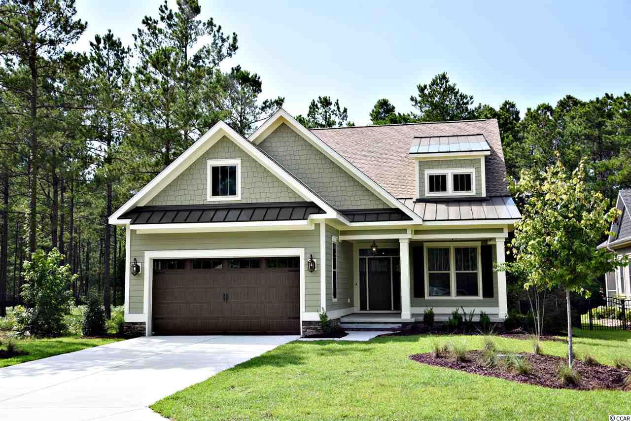 "***Color photos are of a home with a similar floor plan by the same builder. Black and white plans and elevation are of actual home to be built.*** Welcome home to this gorgeous 4-bedroom, 3-bath custom home in the desirable Waterbridge community in Carolina Forest! Custom home builders Heritage Building and Design will let you pick out exactly what you want on this large, nearly half acre lot that backs up to protected woodlands. The lot is particularly deep, allowing plenty of room for a private pool. High end finishes will impress even the most hard to please buyer with coffered ceilings, wainscoting, crown moulding, and 7.25"" baseboards throughout! Everything is energy efficient: the tankless gas water heater, the 16 SEER variable speed HVAC system, insulated garage doors and Low-E windows and doors. The kitchen features granite countertops, tile backsplash, soft close cabinetry and a healthy appliance allowance from either Kitchenaid or GE...your choice! Both the master bathroom and first floor guest bathroom feature custom tile showers. All of the bedrooms feature wood closet shelving. Outside, you'll enjoy a fully landscaped and irrigated lawn. Residents of Waterbridge enjoy unparalleled amenities and award winning schools. Amenities include a resort-style clubhouse with South Carolina's largest residential pool and swim up refreshment bar, community meeting rooms with a full-size kitchen, a 24-hour fitness center, small boat storage, a boat launch on the 60 acre Palmetto Lake, a fire pit, and walking trails galore. For the sports enthusiast, there are also tennis, pickleball, basketball, sand volleyball, and bocce ball courts. All of this is situated amongst over 80 acres of lakes and natural areas, and just a short drive to the beach! ""Heritage Building and Design strives to create an overall home building experience that is custom-tailored and worthy enough to indulge even the most discerning tastes in quality, service, and satisfaction."" You will not be disappointed!"