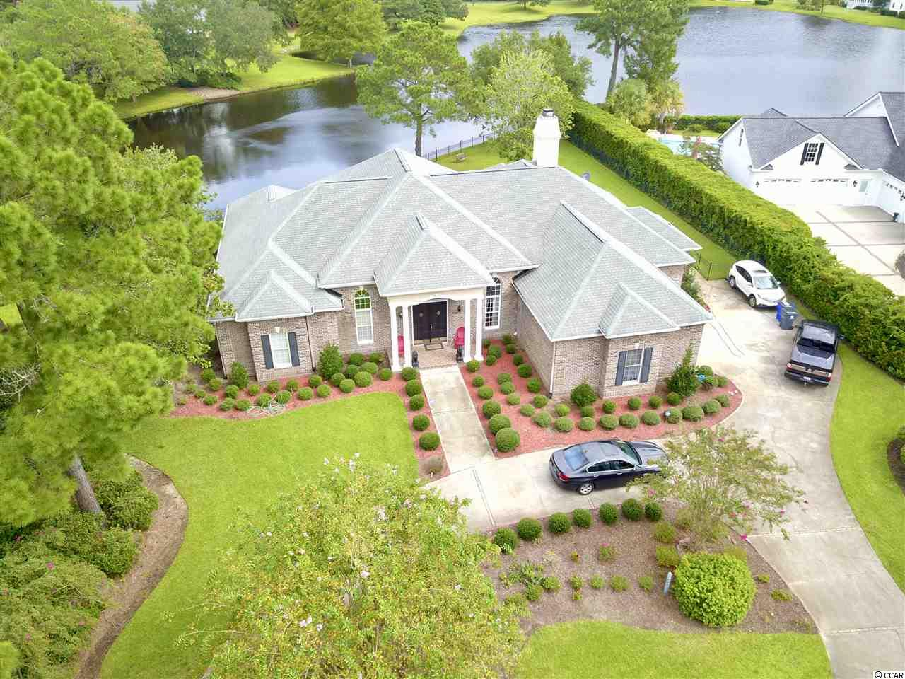 Welcome Home! 4415 Indigo Lane is an all brick single story custom built home with beautiful lake views located in the prestigious Richmond Hill section of Wachesaw Plantation. This wonderful home has been meticulous cared for and it shows. Custom details throughout this exceptional property make it truely unique. Wachesaw Plantation is located the heart of Murrells Inlet, is a 24 hour guard gated community with a Tom Fazio Private Golf Course and Tennis Club with swimming pool, a restaurant overlooking the river. Also convenient to area beaches, shopping, fine restaurants, Tidelands Community Hospital and everything The Grand Strand has to offer. Don't miss this opportunity. Schedule your showing today!