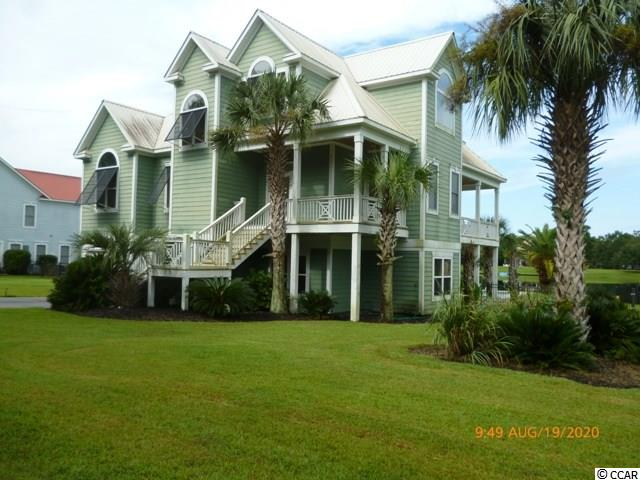 Great location! Raised beach house with pond view, inground pool, 4 bedrooms, 3 baths, great views of lake from upstairs bedrooms.  Located close to Wacca Wache Marina and Murrells Inlet Marsh Walk.  Short drive to the beach, shops and restaurants.  Call today to schedule showing.