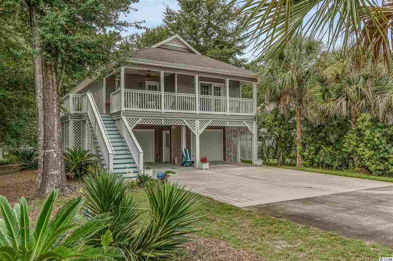 Raised Beach House with a fenced in back yard and a newly built back deck! There is lots of room for entertainment with the fully enclosed downstairs and extra bedroom located underneath. You are close to the Intracoastal Waterway for some amazing sunset views. If you enjoy hiking Vereens Memorial Garden has it all!! Just a few minutes up the road you have multiple walking trails, one being a wooded bridge that takes you over the Marsh Walk leading to the Intracoastal Waterway.  *NEW HVAC INSTALLED AS OF 10/24/2020*  Multiple restaurants are walking distance from the house on Mineola Avenue, or you can take a short trip to North Myrtle Beach and have the experience of the Beach Lifestyle.